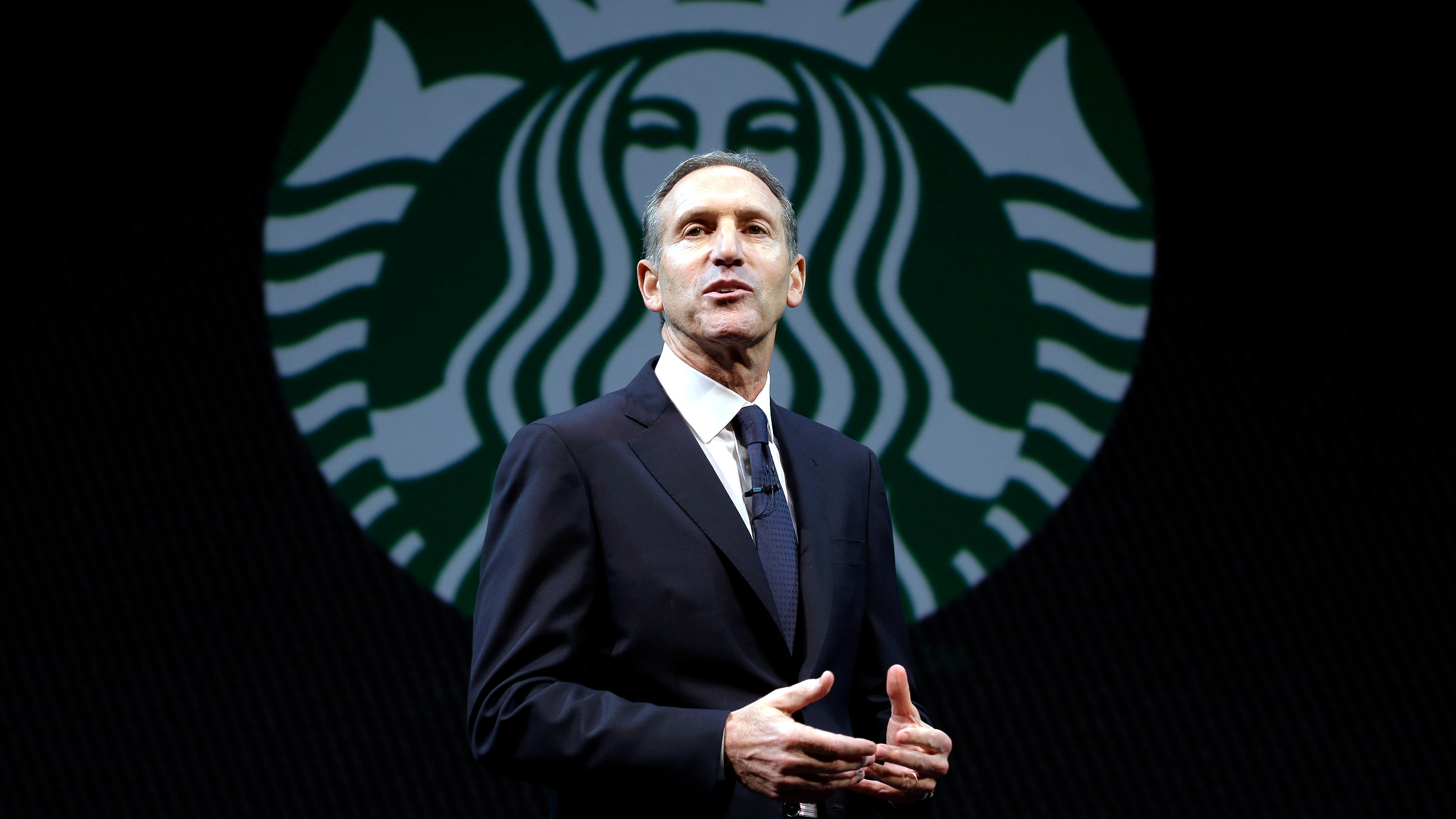 In this Wednesday, March 20, 2013, file photo, Starbucks CEO Howard Schultz speaks at the company's annual shareholders meeting,in Seattle, Wash. Starbucks Corp. reports quarterly financial results after the market closes on Thursday, April 25, 2013.