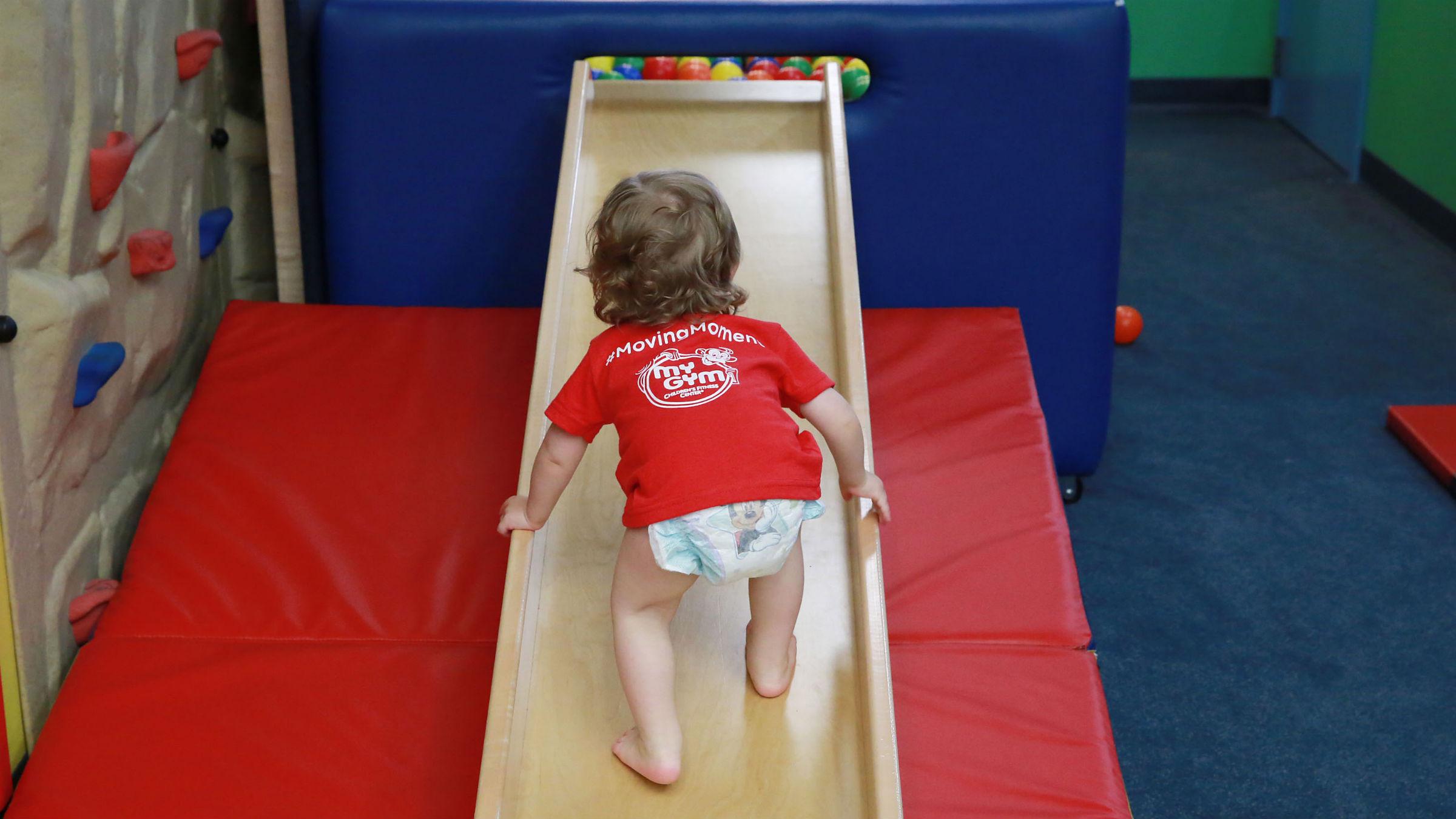 Baby climbing a slide