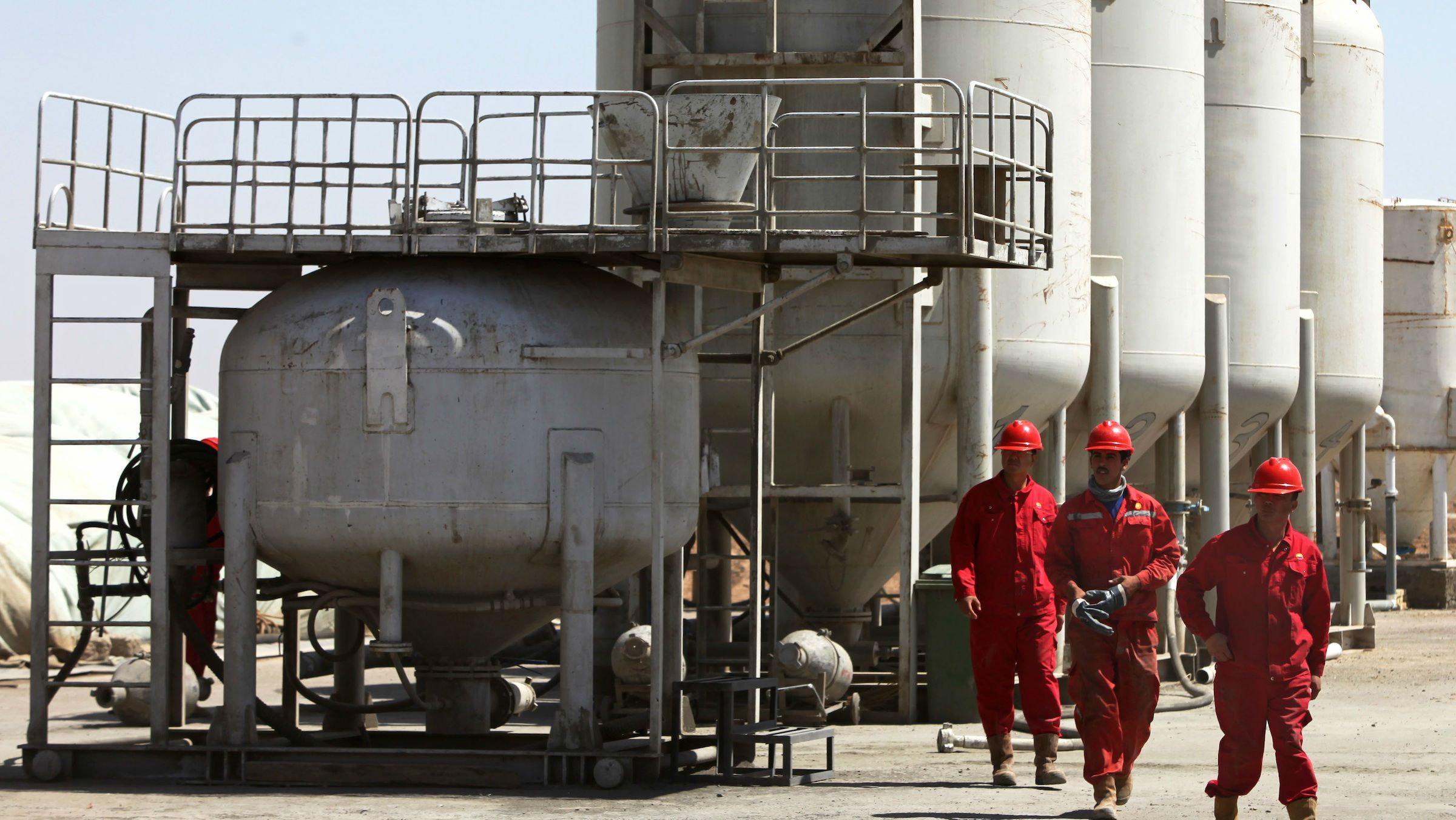 workers are seen at the al-Waha Oil Company in Wasit in southern Iraq. From among the most outspoken of critics of the 2003 U.S.-led invasion to topple former Iraqi dictator Saddam Hussein, China has emerged as one of the biggest economic beneficiaries of the war, snagging lucrative deals and shrugging off the security risks with the country's political instability for the promise of oil, while western firms were largely subdued in their interest in Iraq's recent oil auctions.