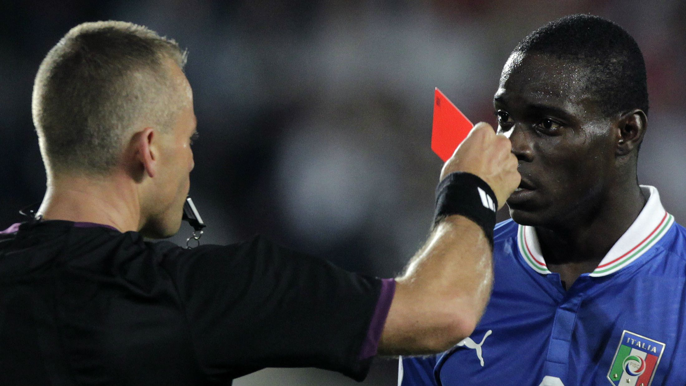 Italy's Mario Balotelli is given a red card.