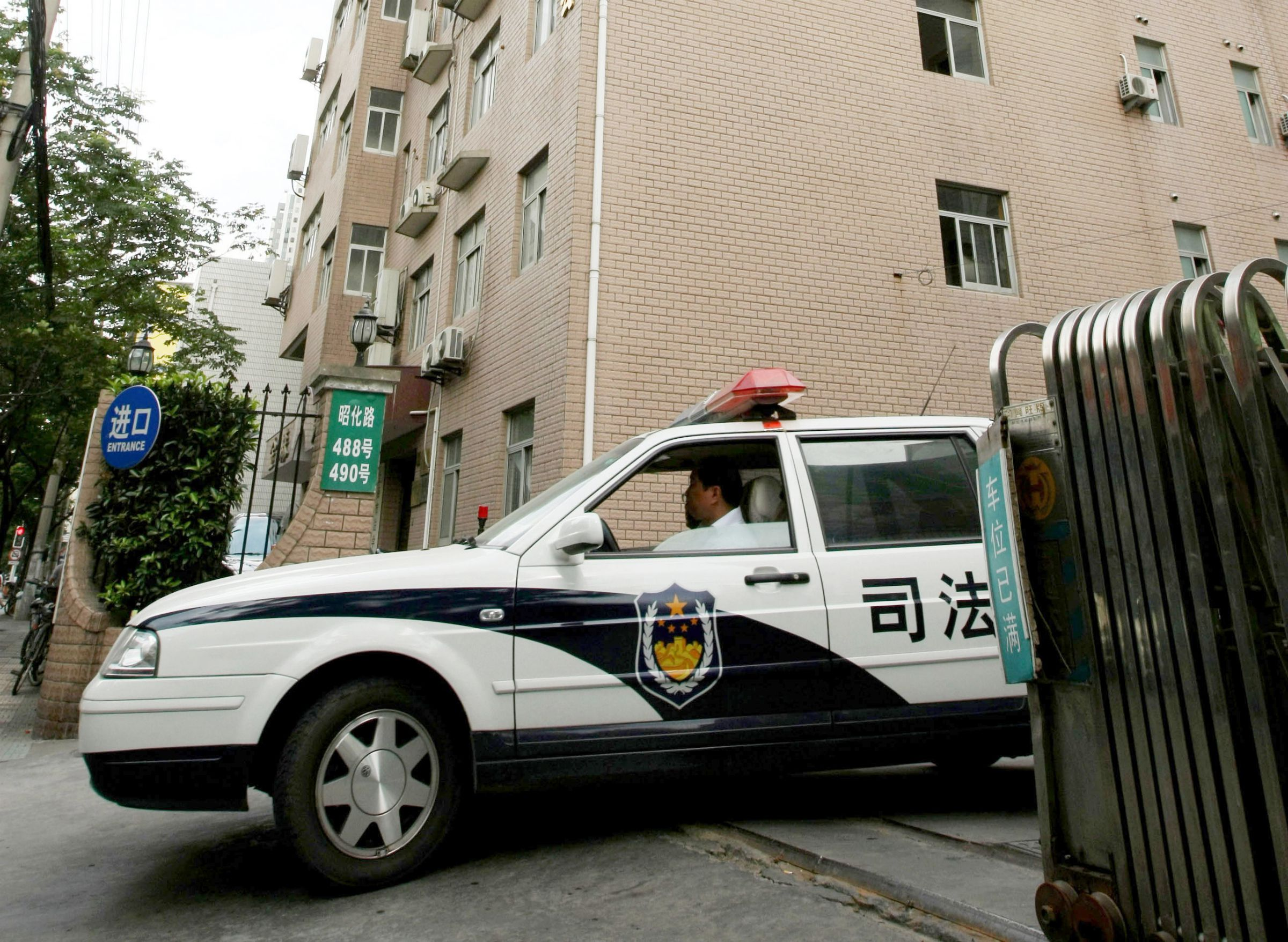 A judicial affair office car drives out at an office-apartment building where a young Canadian model Diana O'Brien was found dead Wednesday, July 9, 2008 in Shanghai, China. An official in the news department of Shanghai's Public Security Bureau said that police got an emergency call early Monday about the death of O'Brien. Police said Wednesday they suspect she was murdered. (AP Photo/Eugene Hoshiko
