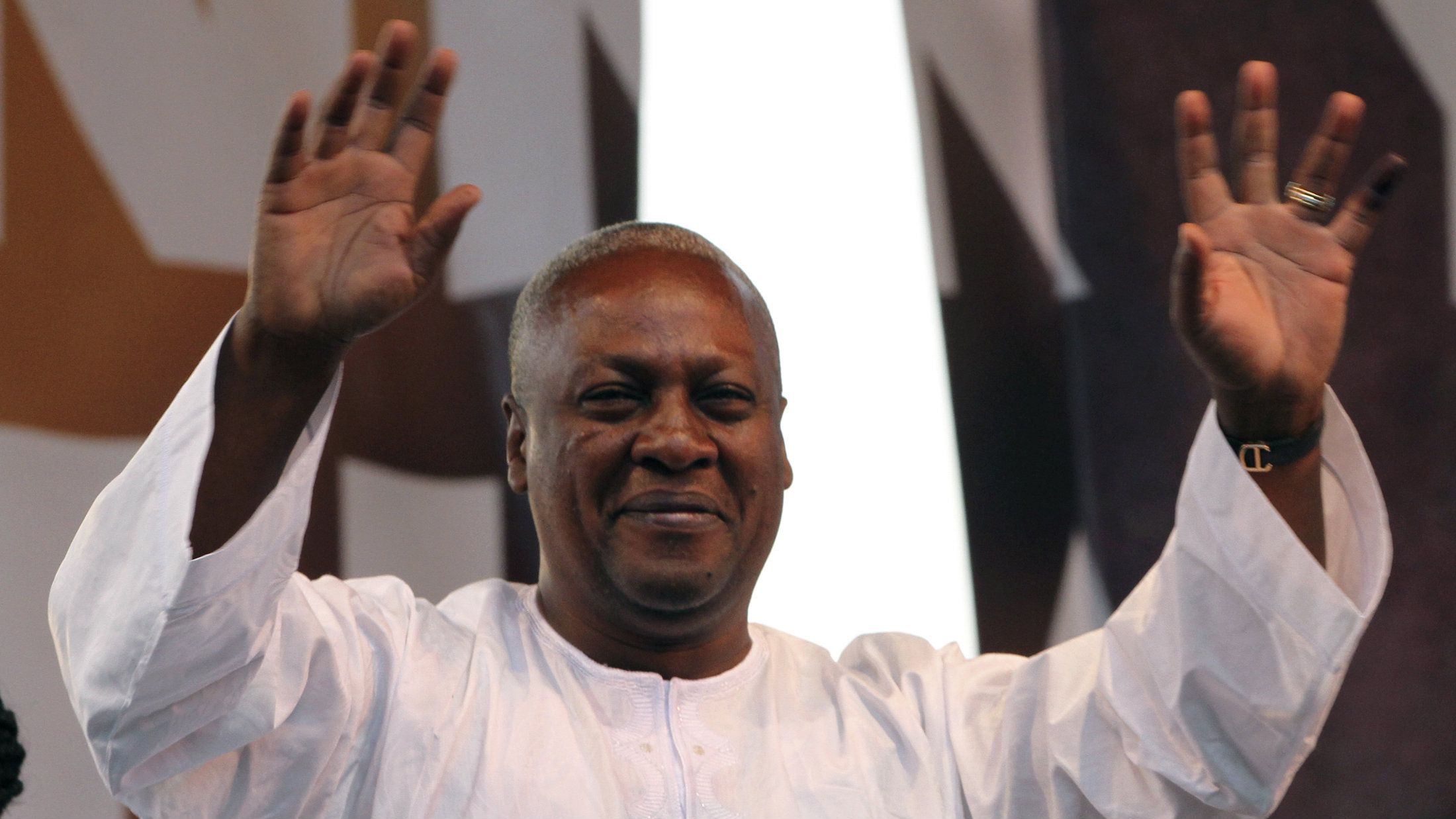 Ghanaian newly elected president John Dramani Mahama waves as he attends a victory rally to thank the supporters of NDC (National Democratic Congress), the party of the late president John Atta Mills, in Accra December 10, 2012.