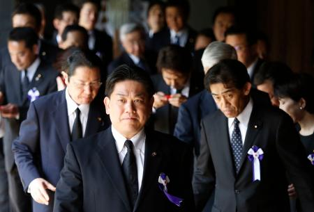 A group of lawmakers walk after offering prayers at the Yasukuni Shrine in Tokyo August 15, 2014, to mark the 69th anniversary of Japan's surrender in World War Two. Japanese Prime Minister Shinzo Abe on Friday sent a ritual offering to a Tokyo shrine to war dead but did not join cabinet ministers in a visit, seen as an effort to avoid further inflaming ties with China as he seeks a summit with Beijing. REUTERS/Yuya Shino