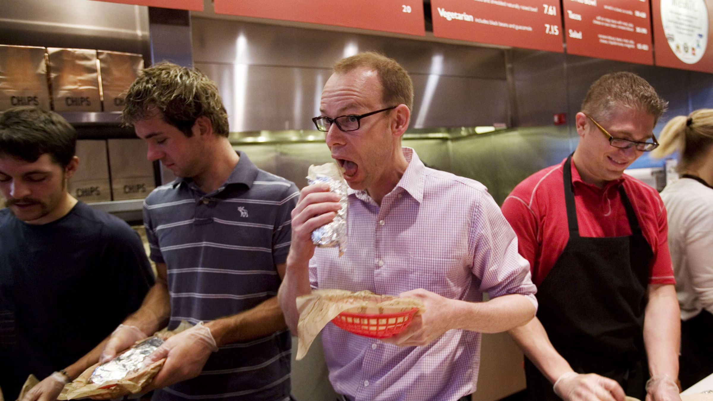 Man eating burrito at Chipotle event