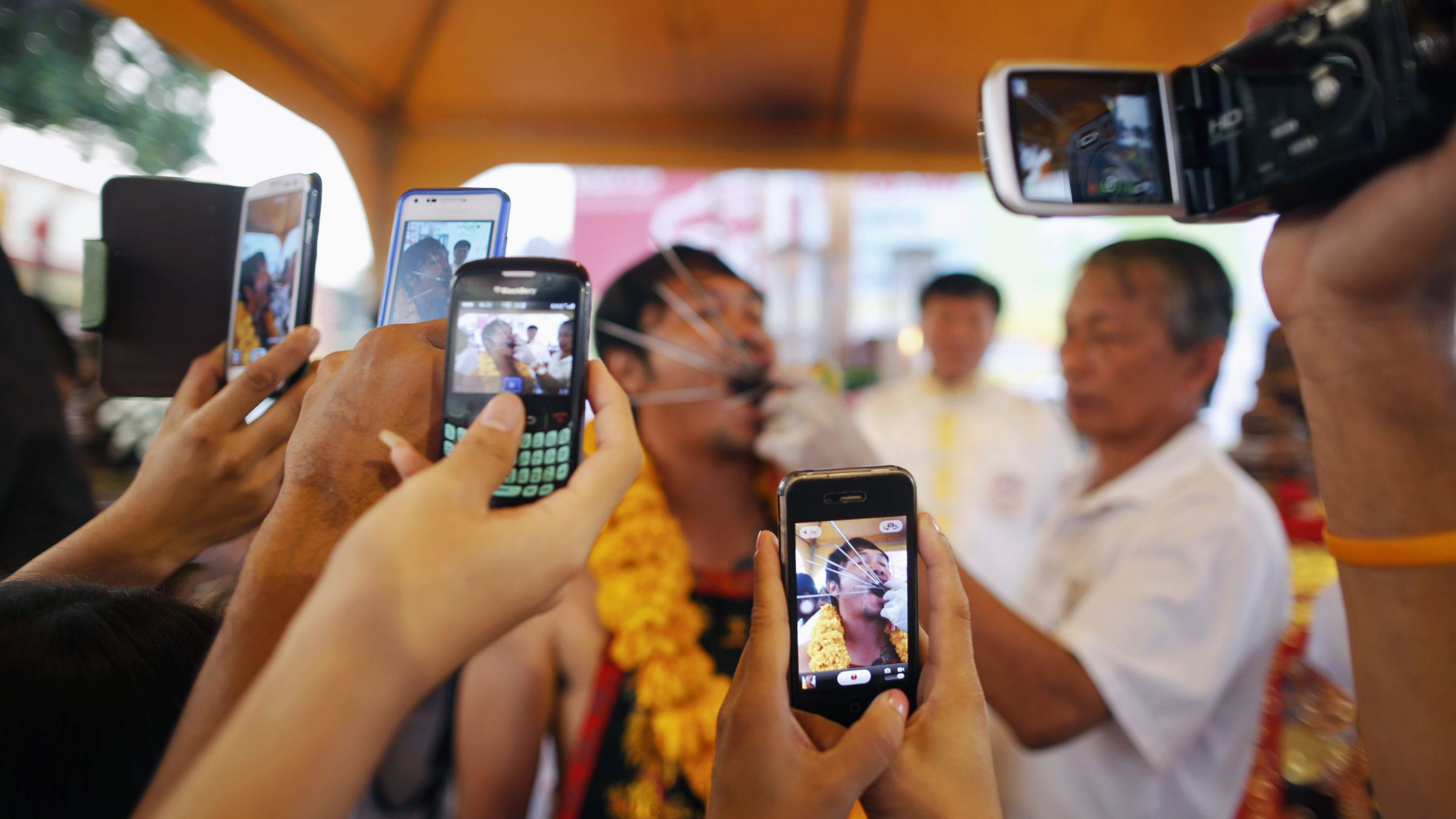Multiple phone cameras record a man in Phuket.