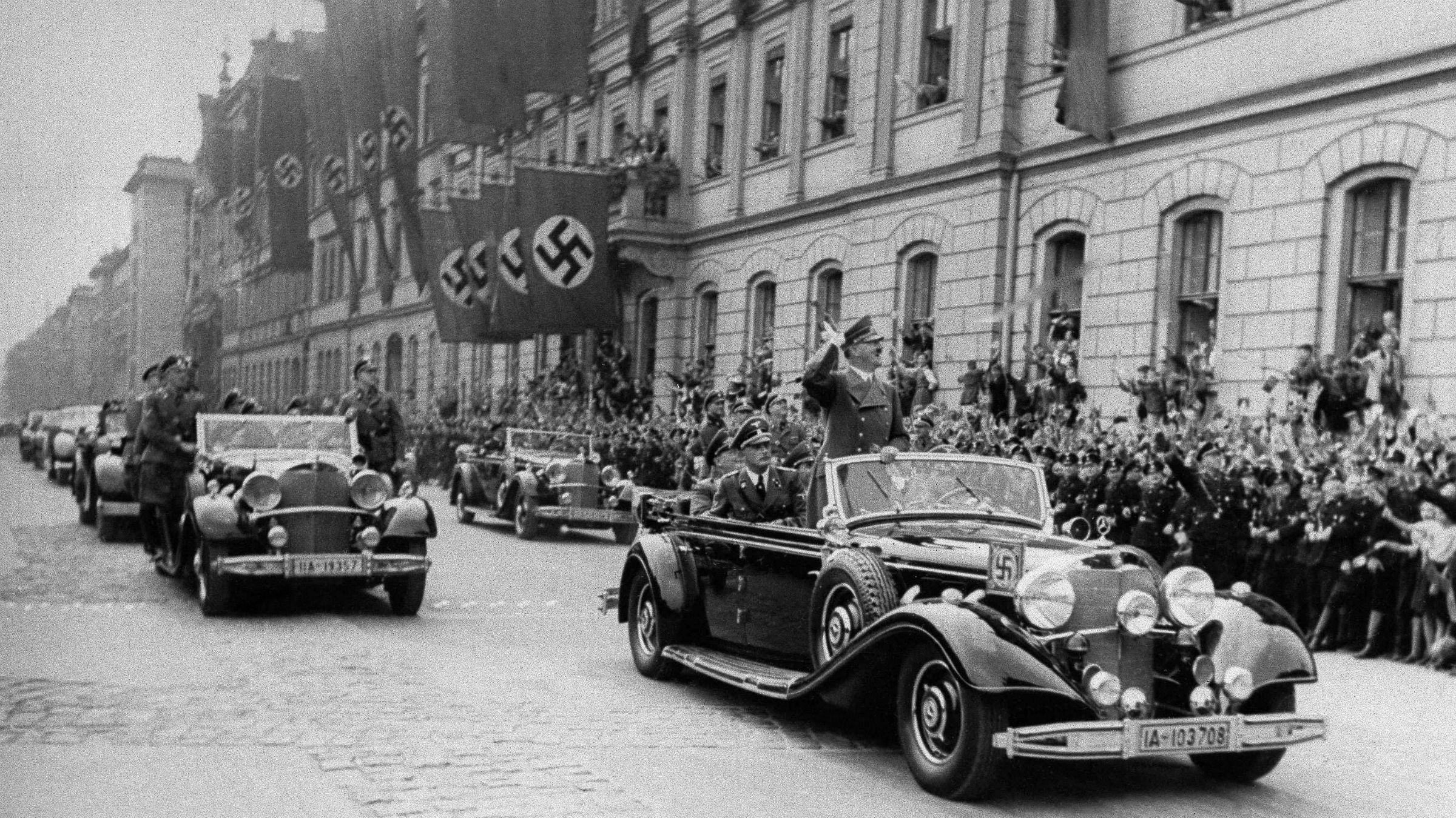 Nazi parade scene with Hitler in a car