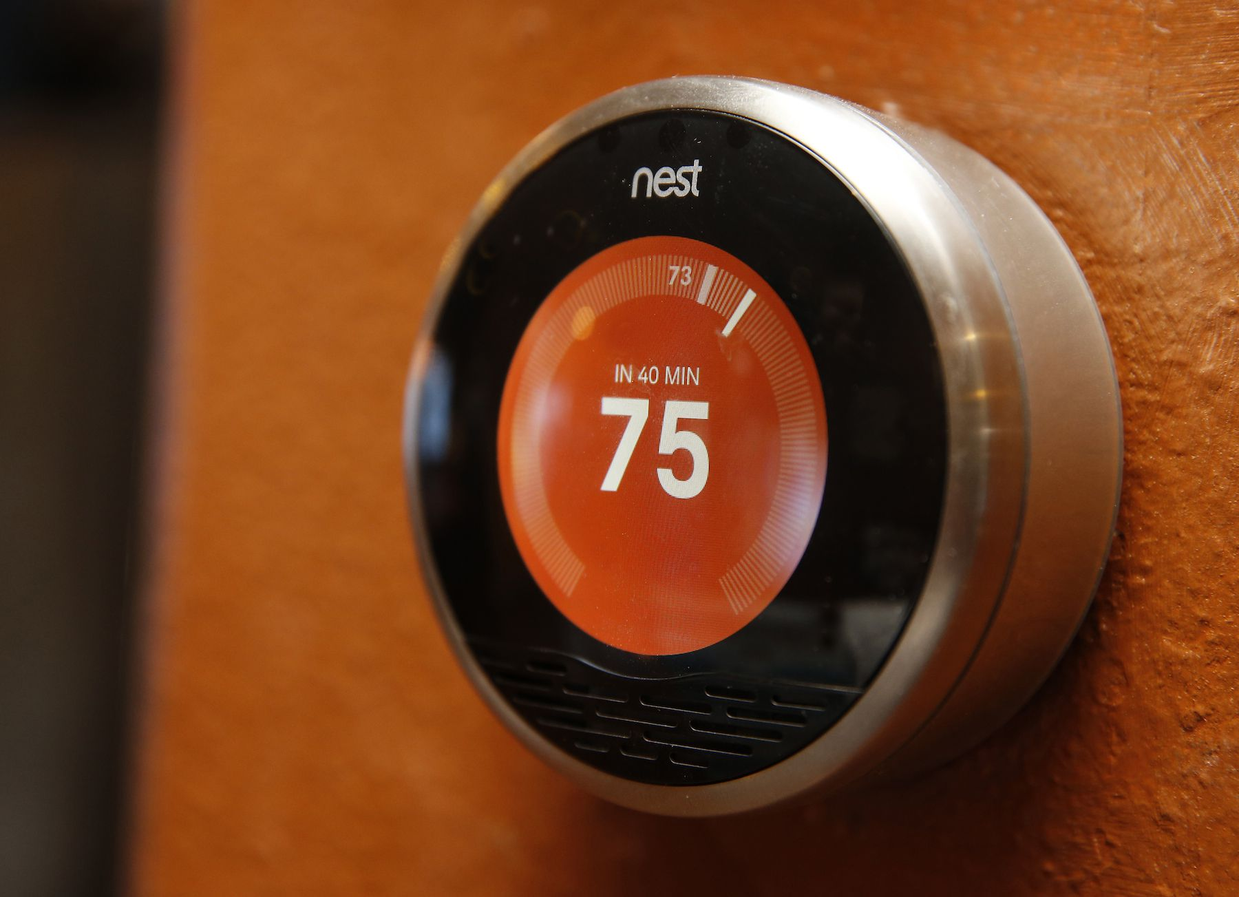 "A Nest thermostat is installed in a home in Provo, Utah, January 15, 2014. Google Inc took its biggest step to go deeper into consumers' homes, announcing a $3.2 billion deal January 13, 2014 to buy smart thermostat and smoke alarm-maker Nest Labs Inc, scooping up a promising line of products and a prized design team led by the ""godfather"" of the iPod. REUTERS/George Frey (UNITED STATES - Tags: BUSINESS SCIENCE TECHNOLOGY) - RTX17ON5"