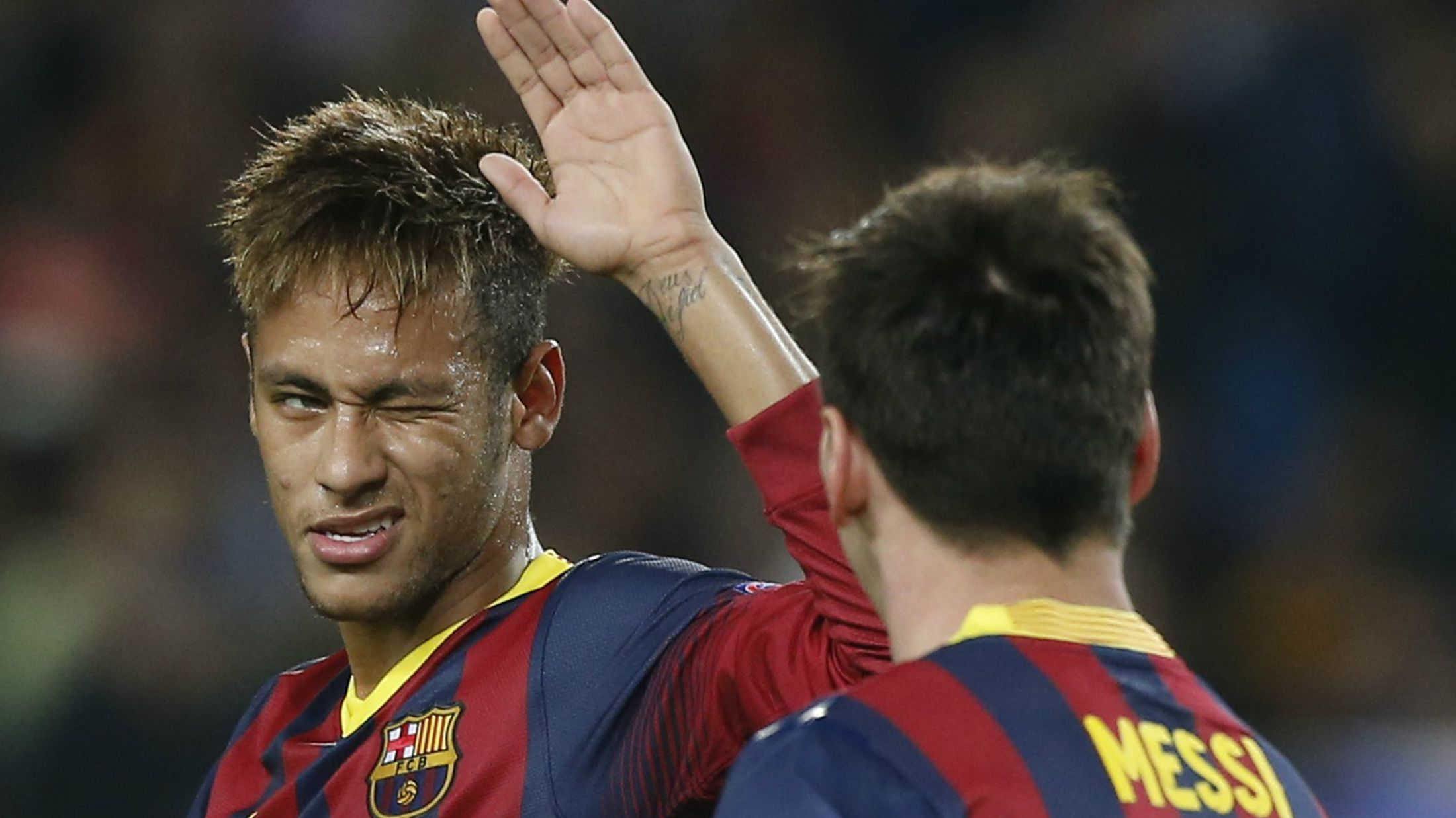Neyman high-fives teammate Messi