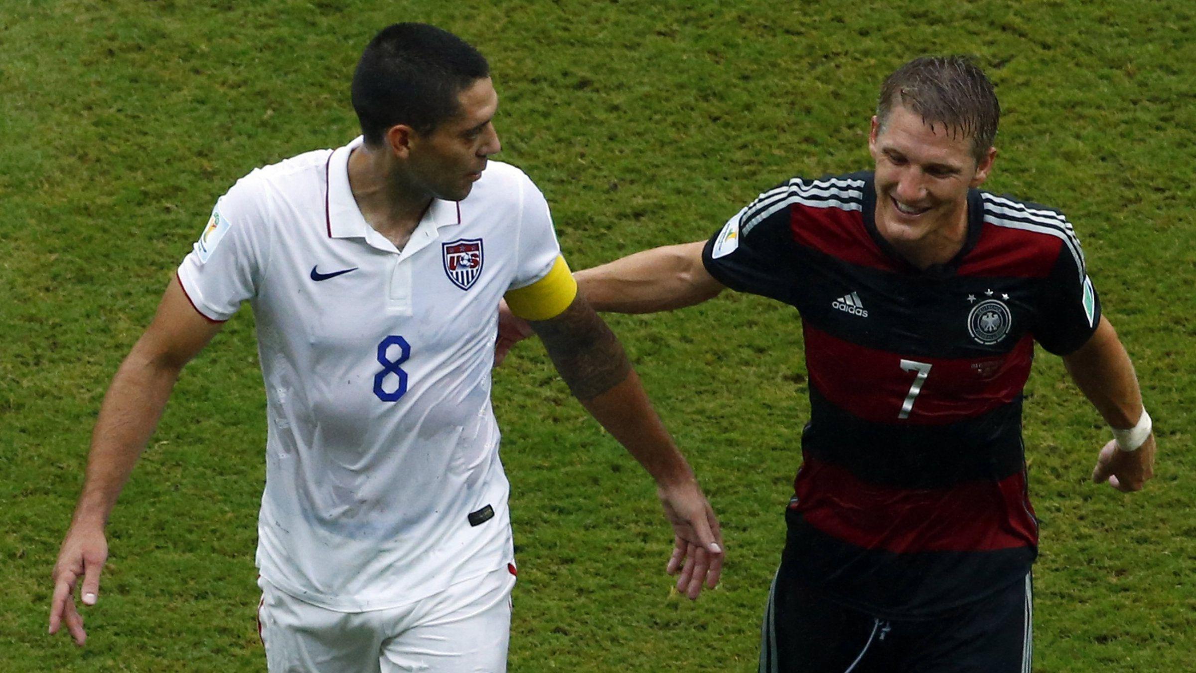 Clint Dempsey of the U.S. and Germany's Bastian Schweinsteiger talk