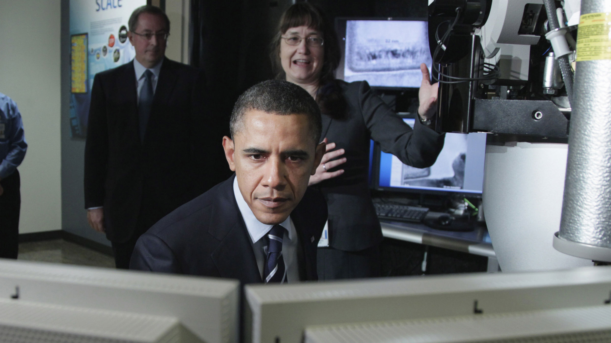 President Barack Obama, accompanied by Barbara Miner, PhD, Manager, Intel Transmission Electronic Microscope Lab, right, and Intel CEO Paul Otellini, second from left, looks at a computer screen at the Intel Corporation with in Hillsboro, Ore., Friday, Feb. 18, 2011
