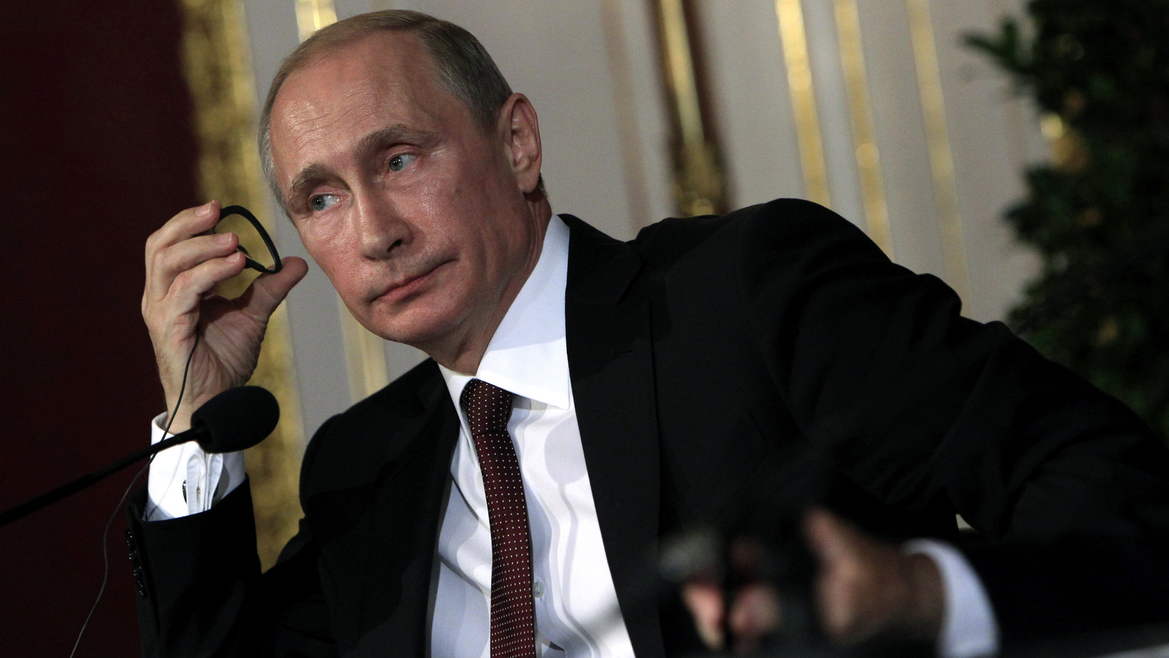 Russian president Vladimir Putin listens to a question in a news conference June 24 in Austria.