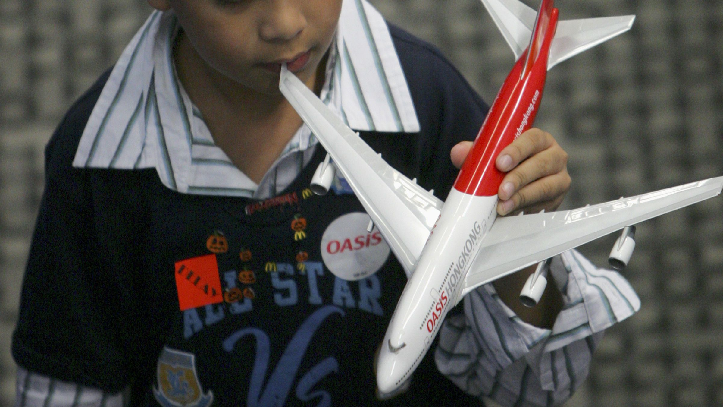 Child with model airplane