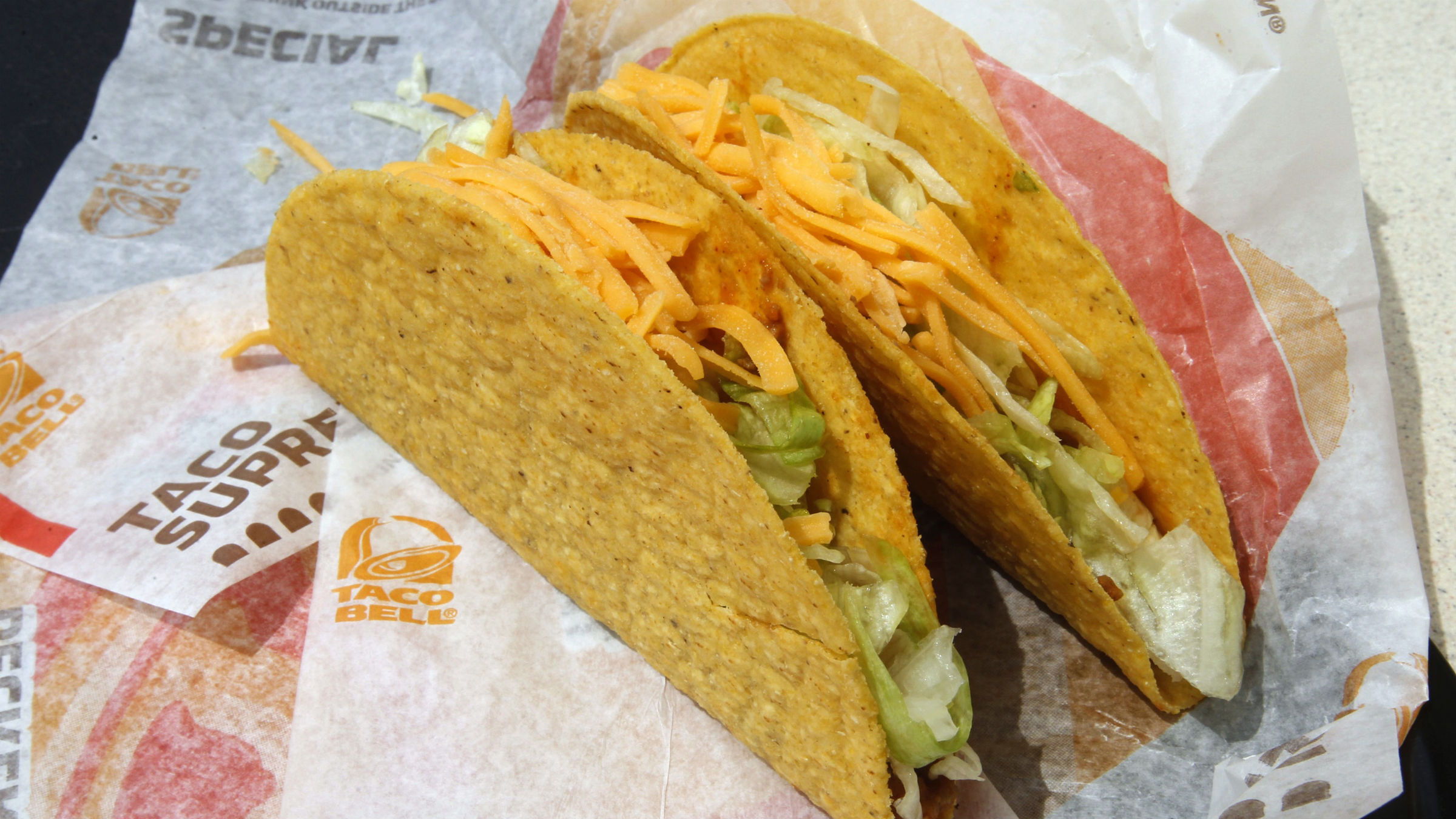 Two crunchy tacos are pictured at a Taco Bell restaurant in Glendale, California April 19, 2011. Taco Bell is part of Yum! Brands, the world's largest company of system restaurants, including Pizza Hut, Taco Bell, and KFC. Yum! Brands releases earnings April 20.