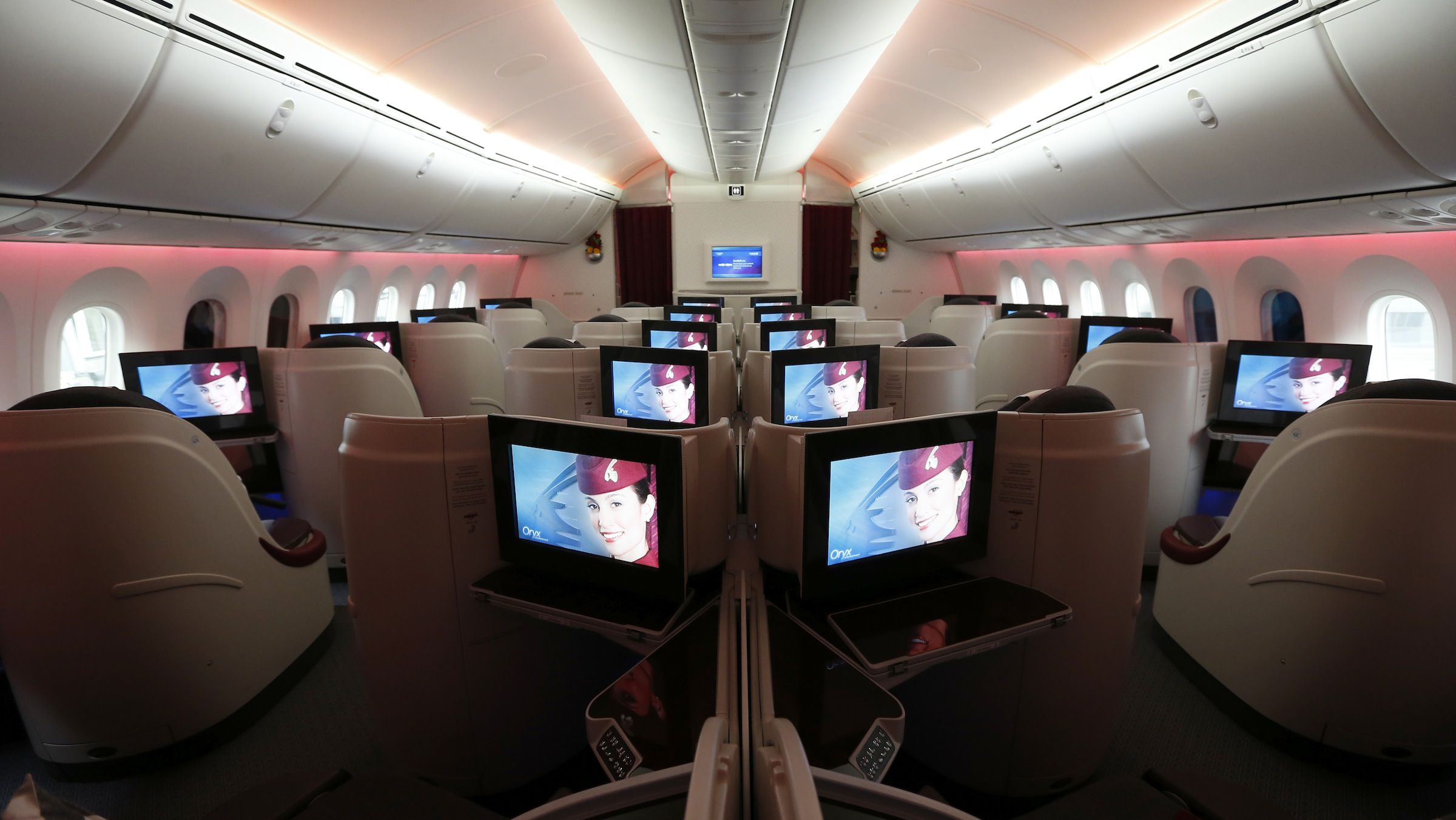 Seats and screens in the business class cabin of Qatar Airways' new Boeing 787 Dreamliner are seen after it arrived on it's inaugural flight to Heathrow Airport, west London December 13, 2012. Qatar Airways is the first airline to operate scheduled Dreamliner flights to and from the UK.    REUTERS/Andrew Winning (BRITAIN - Tags: TRANSPORT BUSINESS SOCIETY TRAVEL) - RTR3BJ6E