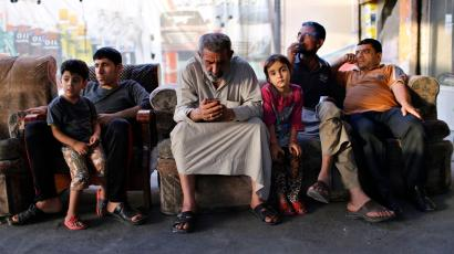An Iraqi Shi'ite man (C) uses his phone as he sits at an outdoor cafe in Sadr City in Baghdad April 29, 2014. Iraq is now gripped by its worst violence since the heights of its 2005-2008 sectarian war, and Sunni Islamist insurgents who target Shi'ites have been regaining ground in the country over the past year. But despite the instability, daily life continues in poor Shi'ite neighbourhoods of Baghdad such as Al-Fdhiliya and Sadr City - a sprawling slum marred by poor infrastructure and overcrowding. Picture taken April 29, 2014.
