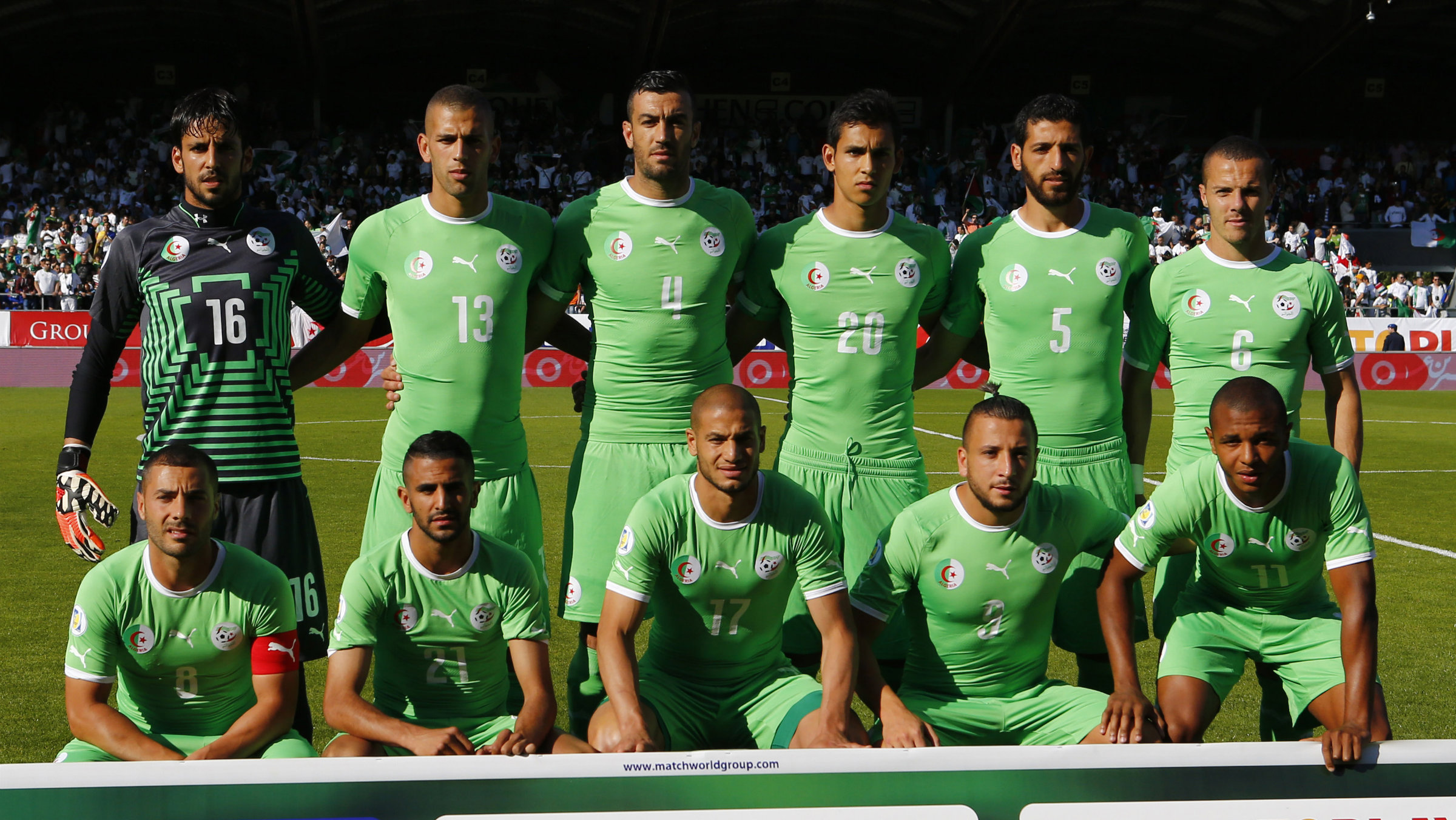 Algeria's World Cup squad lines up for a photo before a match.