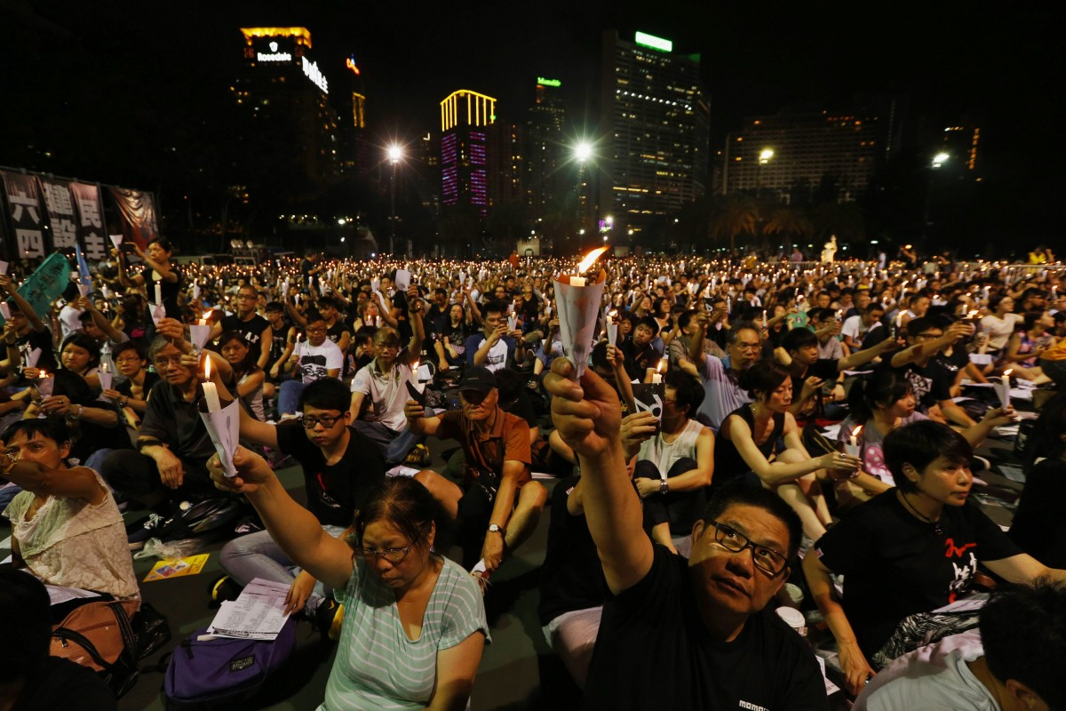 People take part in a candlelight vigil at Hong Kong's Victoria Park on 25th anniversary of June 4th military crackdown on pro-democracy movement in Beijing