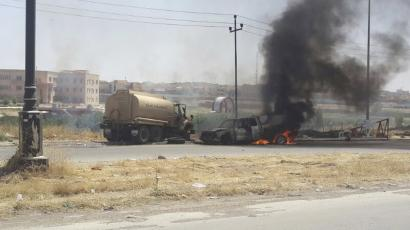 Burning vehicles belonging to Iraqi security forces in Mosul.