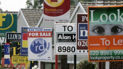 Boards advertising property for sale and rent are seen in east London.