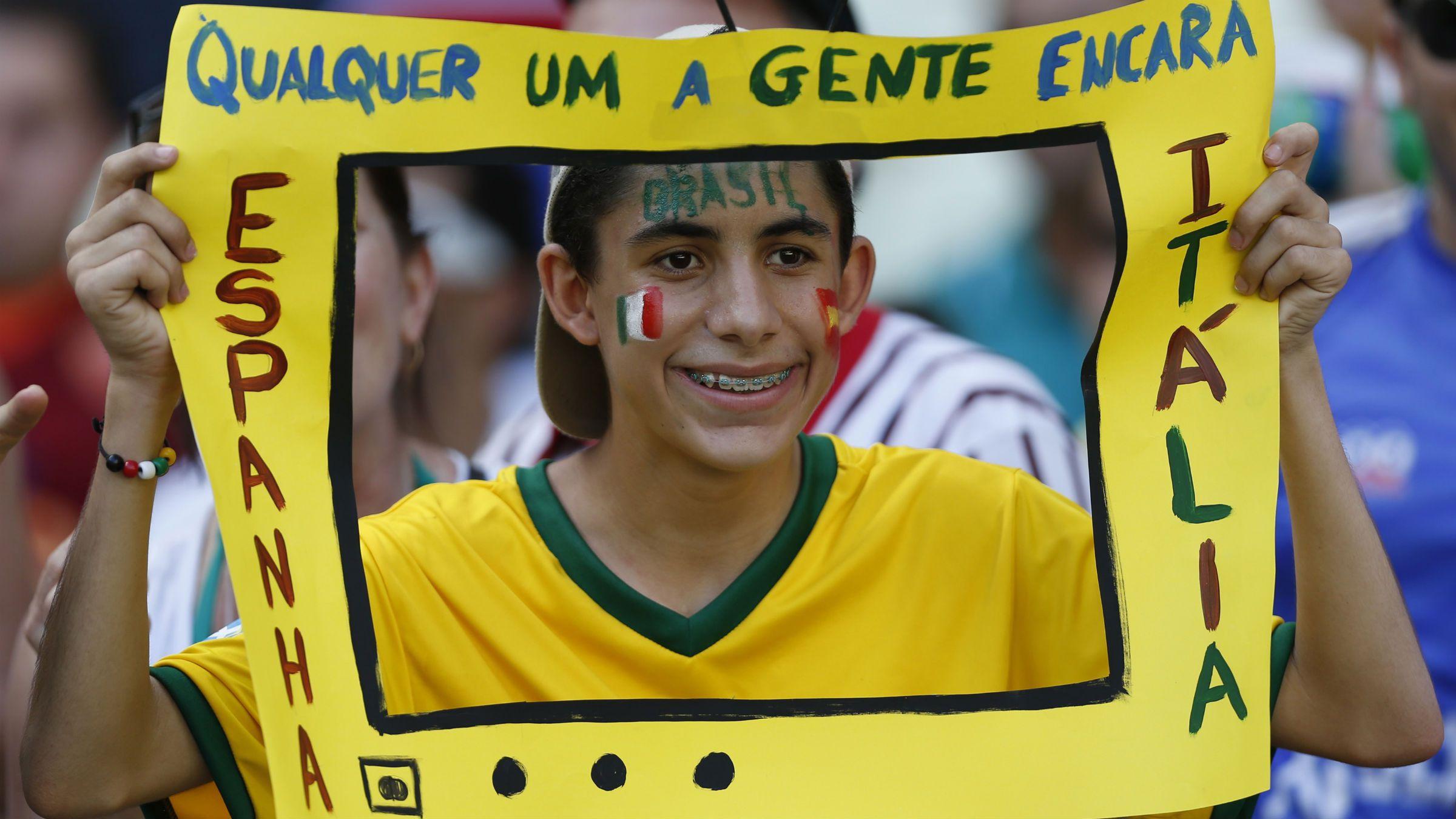 Brazil Fan holds a paper TV