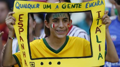 Brazil Fan holds a paper TV