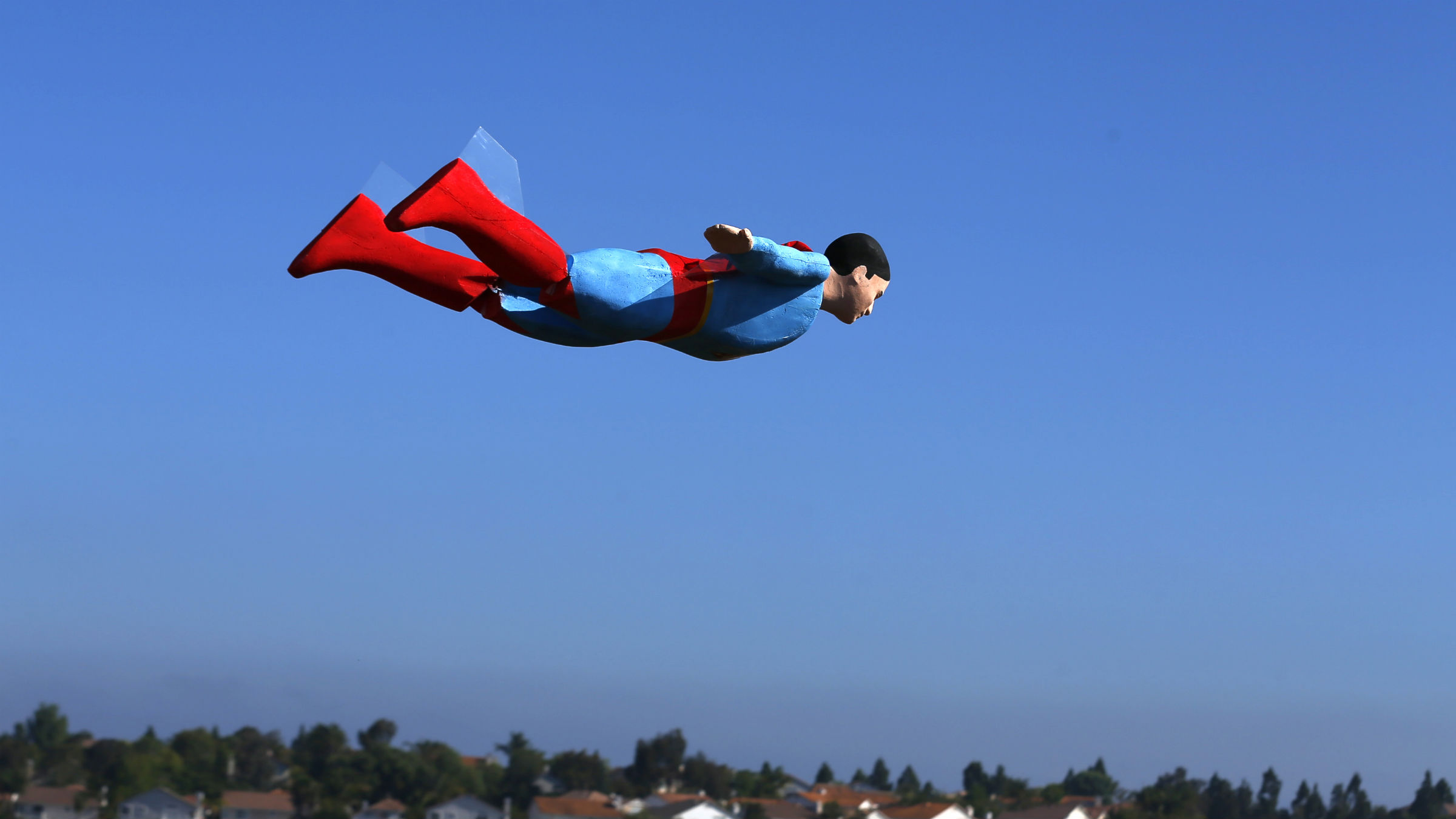 DATE IMPORTED:June 28, 2013A radio-controlled Superman plane is flown by designer Otto Dieffenbach during a test flight in San Diego, California June 27, 2013. Otto and business partner Ed Hanley run a small start-up company that creates flying radio-controlled planes, designed in the form of people, characters and objects, for commercial and promotional uses.