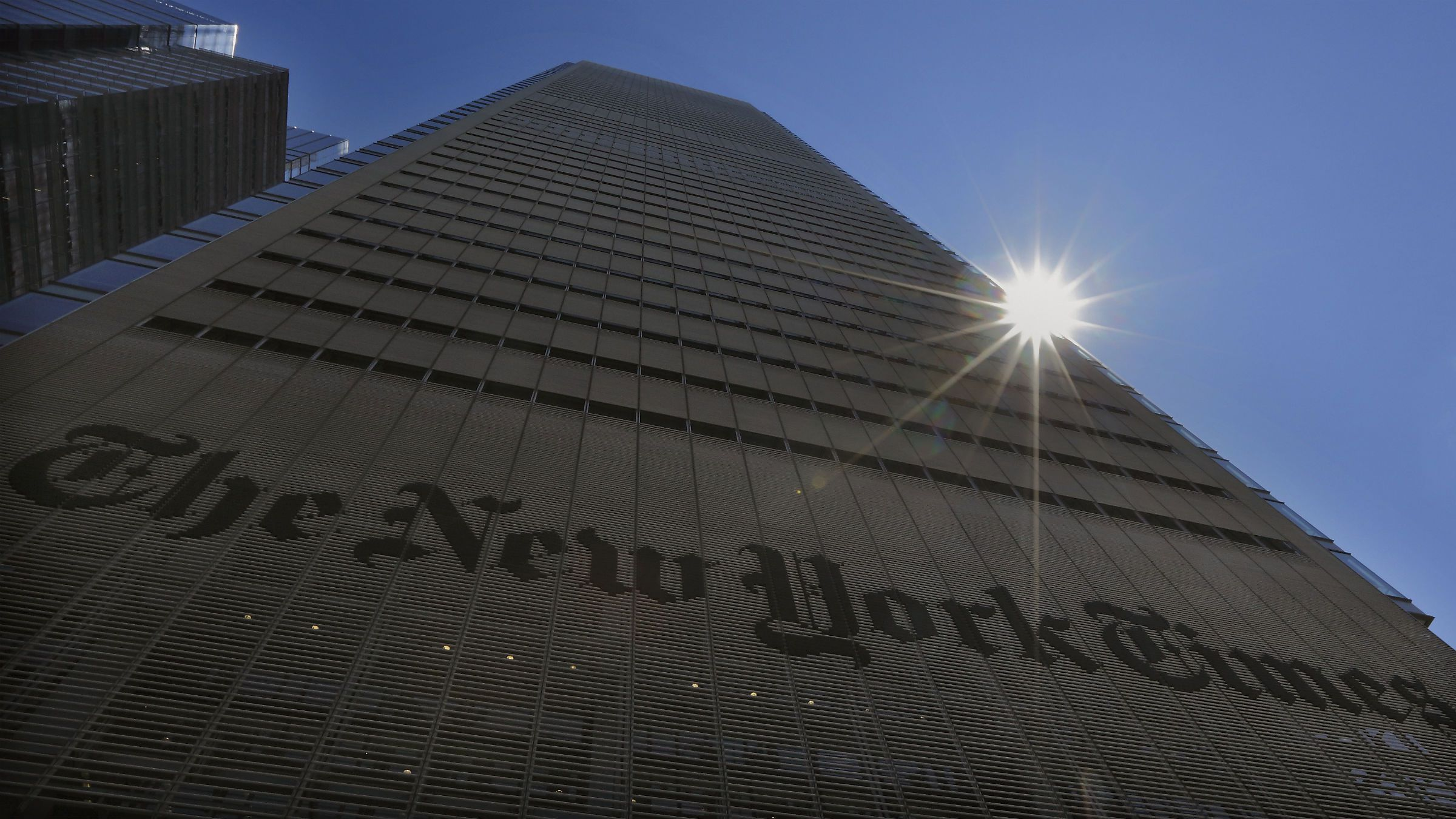 The sun peaks over the New York Times Building in New York August 14, 2013. People accessing nytimes.com earlier on Wednesday saw a message that the service was unavailable. New York Times Co spokeswoman Eileen Murphy said the company thinks the cause of the outage was related to a scheduled maintenance update, which occurred within seconds of the website going down.