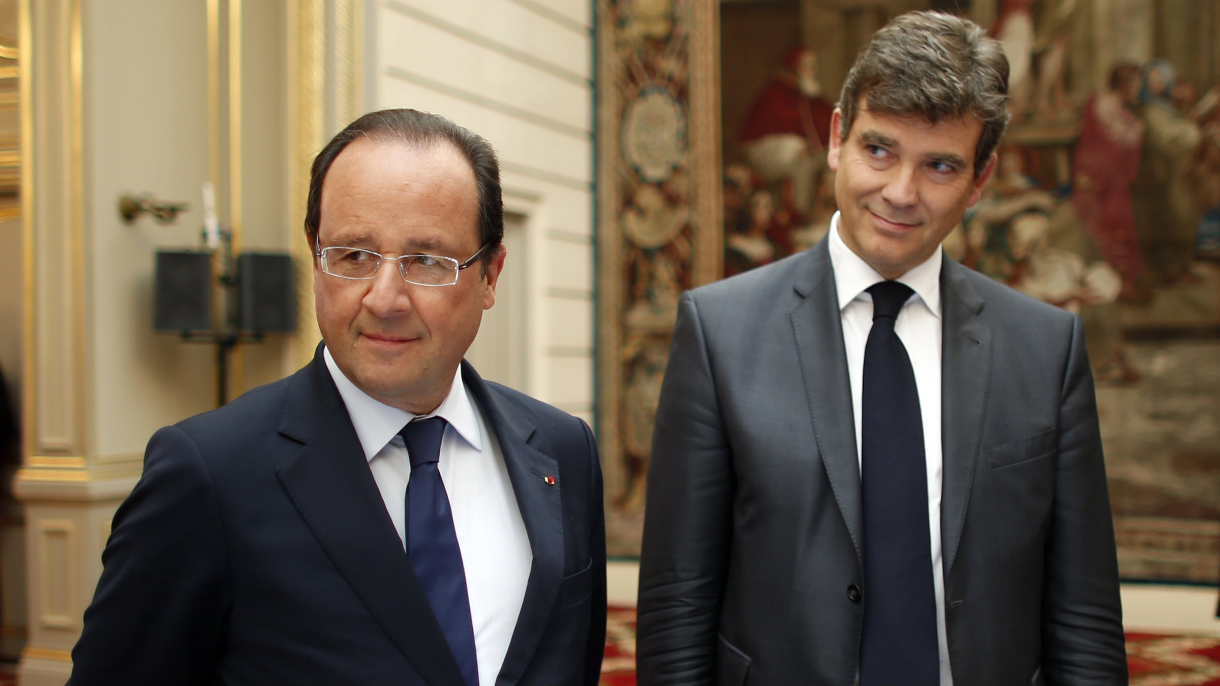 French President Francois Hollande and Minister for Industrial Recovery Arnaud Montebourg at the Elysee Palace in Paris.