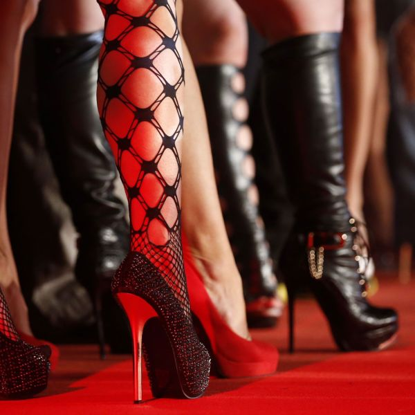 """Porn actresses line-up at the opening of the """"Venus"""" erotic fair in Berlin October 17, 2013. The event, which represents the erotic business in the German capital, is open till October 20, 2013."""