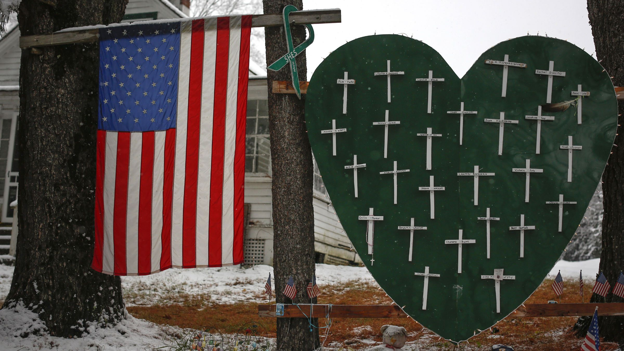 2013A memorial honoring the victims killed in the Sandy Hook Elementary School shooting is seen outside a home in Sandy Hook, Connecticut December 10, 2013. The Connecticut town of Newtown on Monday asked for privacy and a restrained media presence ahead of the anniversary of the shooting that killed 20 children and six adults at Sandy Hook Elementary School.