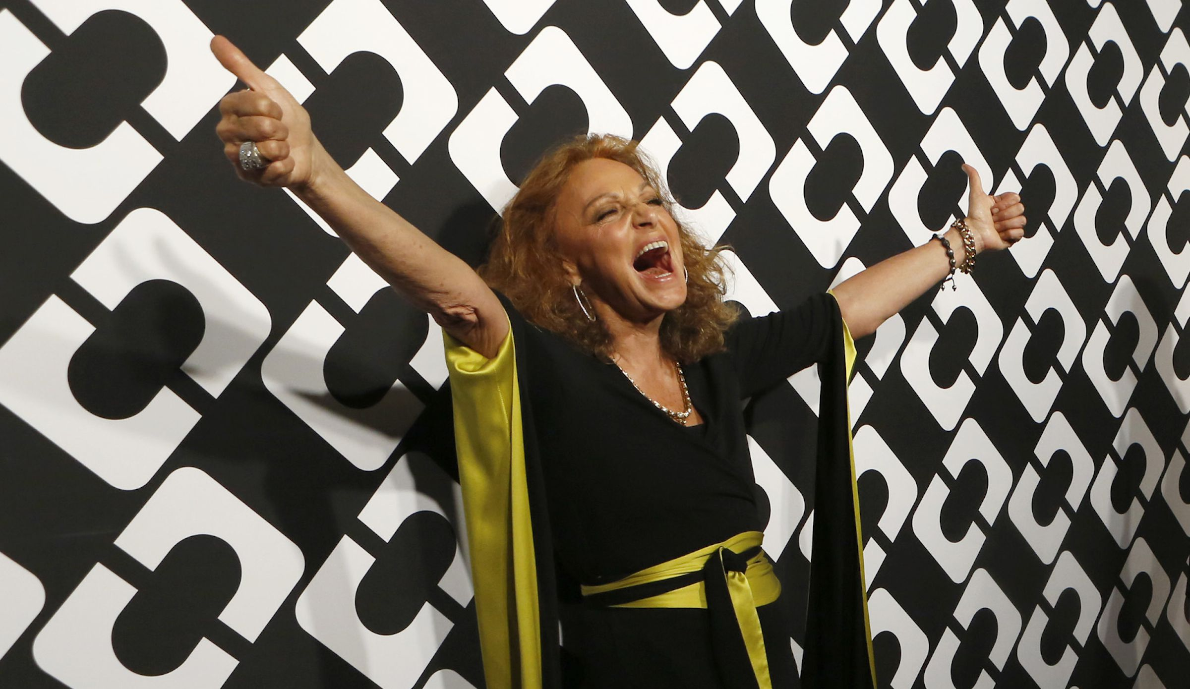 Fashion designer Diane Von Furstenberg poses at the opening of the Journey of a Dress exhibition in Los Angeles, California January 10, 2014.   REUTERS/Mario Anzuoni  (UNITED STATES - Tags: ENTERTAINMENT FASHION) - RTX179AG