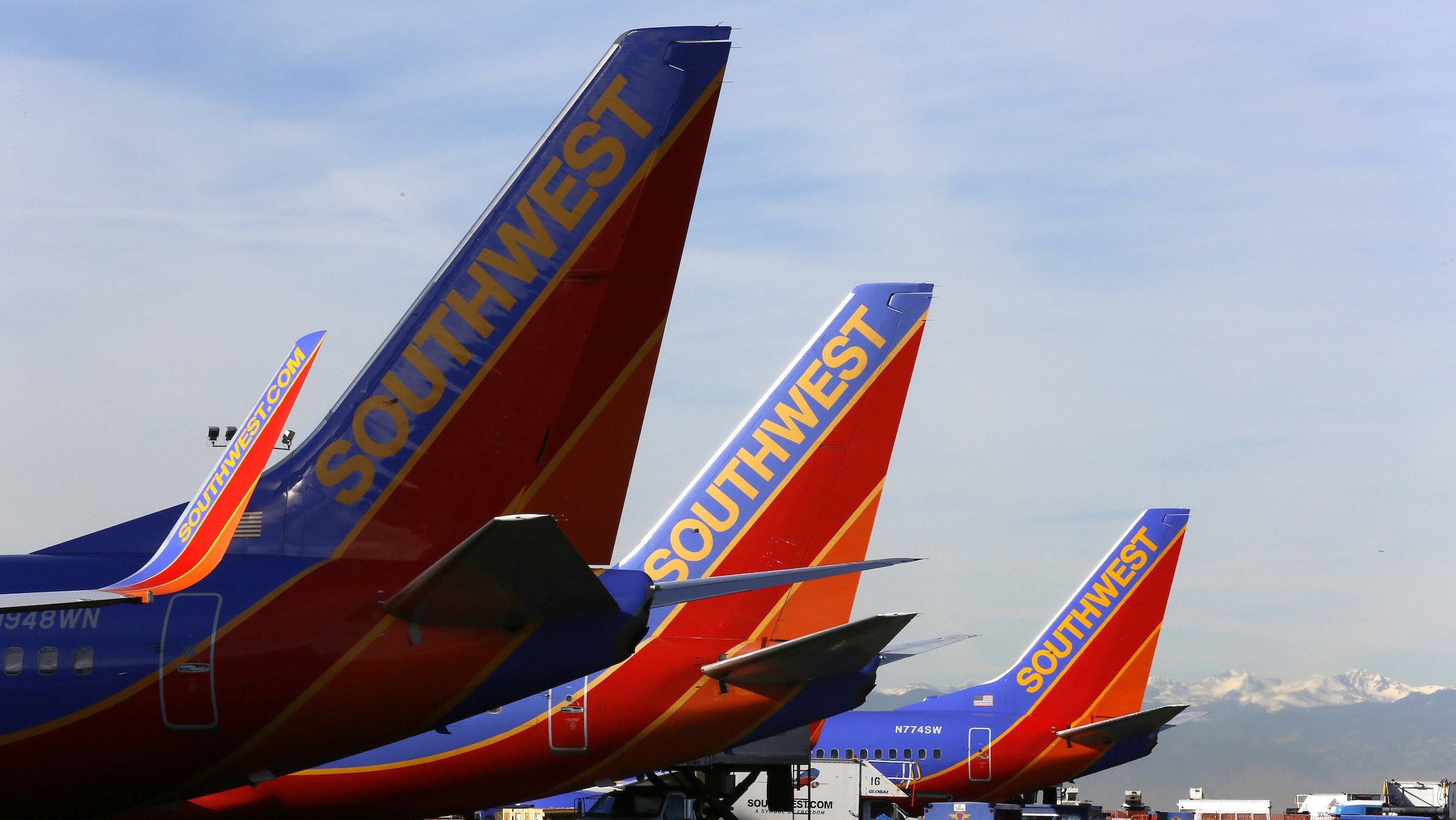 Southwest Airlines jets wait on the tarmac at Denver International Airport in Denver January 22, 2014. Southwest is expected to report higher fourth-quarter results when they announce the results January 23, 2014. The discount airline raised luggage fees at its AirTran unit and launched new fees tied to certain boarding positions at the gate to raise revenue.   REUTERS/Rick Wilking (UNITED STATES - Tags: BUSINESS TRANSPORT) - RTX17QCO