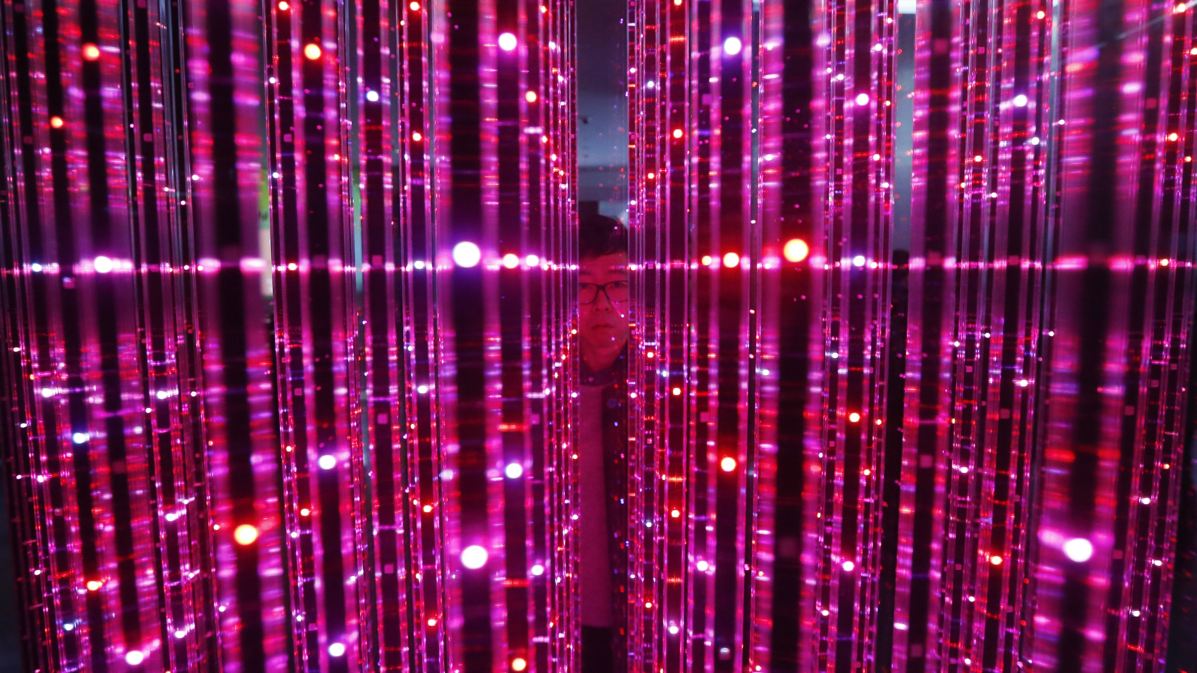 A man stands inside a LED lighting drum, which is made up of more than 40,000 Samsung LED lights, at a Samsung Electronics Co showroom in Seoul