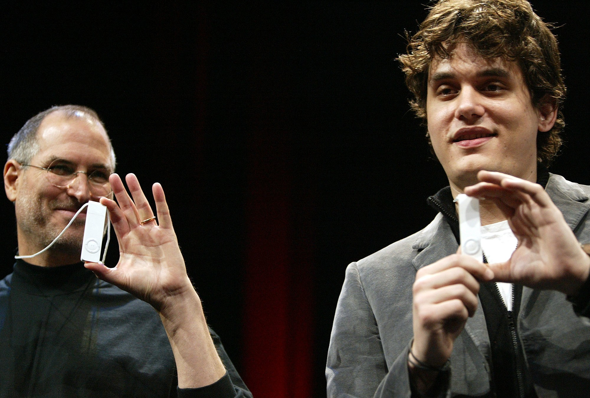 Apple Computer Inc. CEO Steve Jobs, left, and musician John Mayer unveil the new iPod Shuffle after Jobs gave the keynote address and Mayer performed during the Macworld Conference and Expo at the Moscone Center Esplanade in San Francisco on Tuesday, Jan. 11, 2005. (AP Photo/Jeff Chiu)