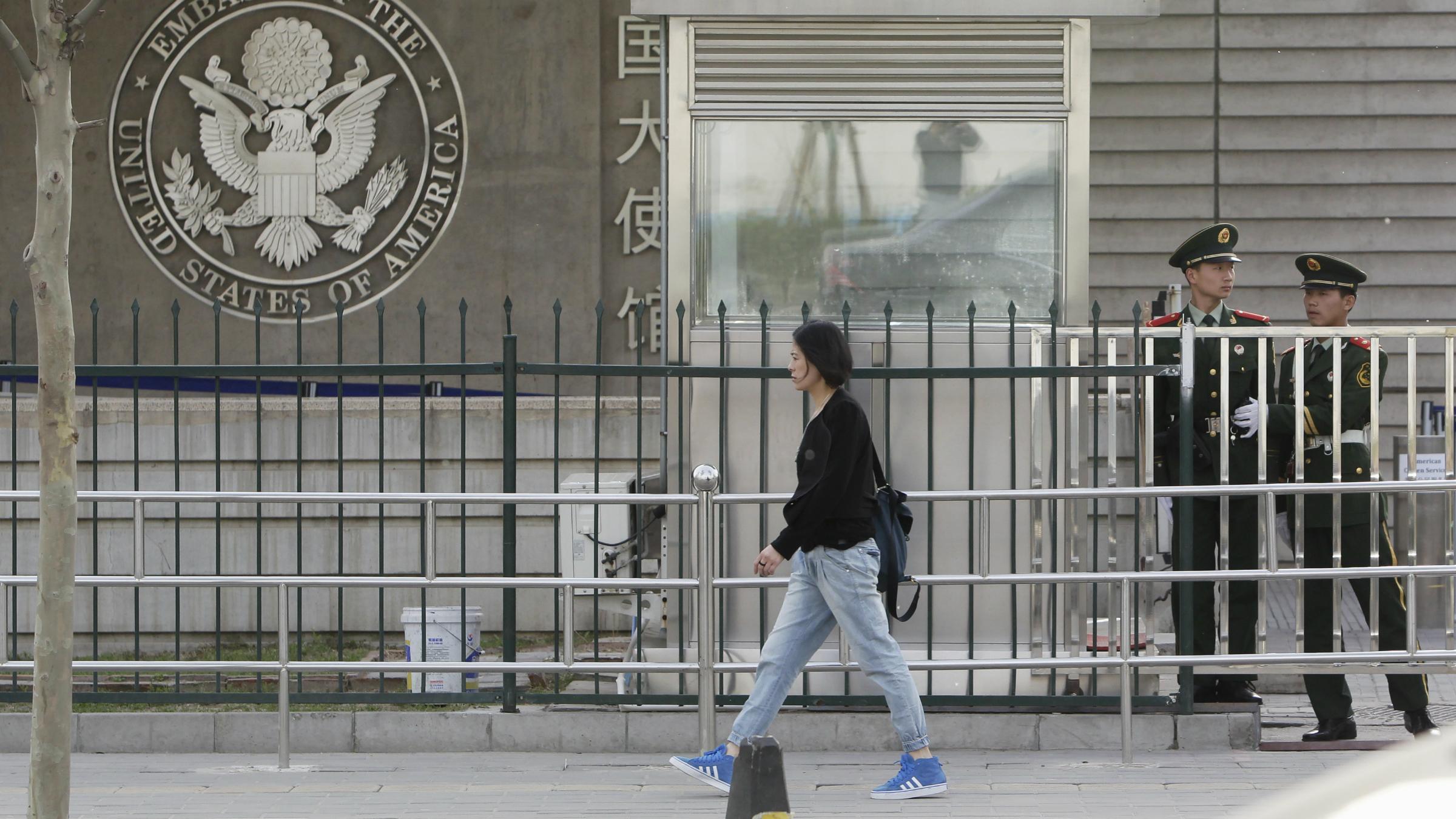 Woman walking in front of US embassy in Beijing.