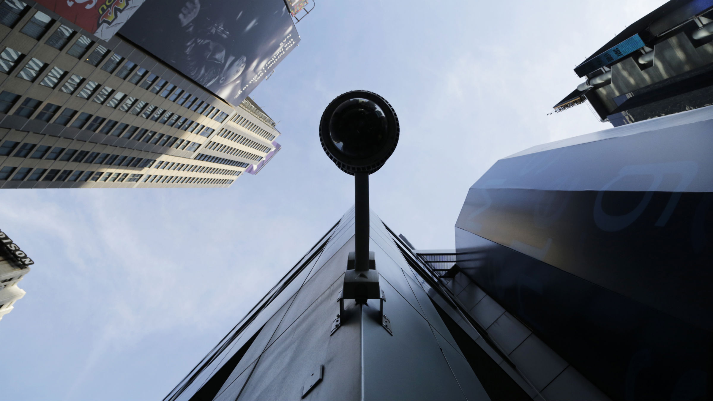 A security camera, center, is mounted on the side of a building overlooking an intersection in midtown Manhattan, Wednesday, July 31, 2013 in New York.