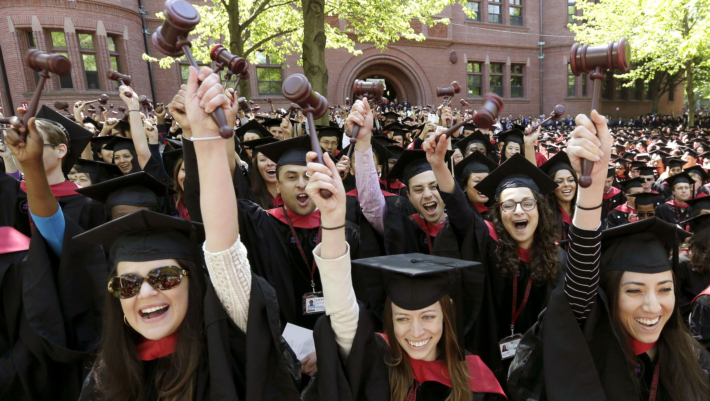 Sarah Ashley Wheaton, center front, joins with other graduates from the Harvard Law School as they wave gavels and cheer during Harvard University commencement ceremonies, Thursday, May 29, 2014, in Cambridge, Mass. (AP Photo/Steven Senne)