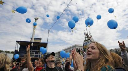 "In Kiev, Ukrainians celebrated the country's signature of an ""association agreement"" with the European Union."