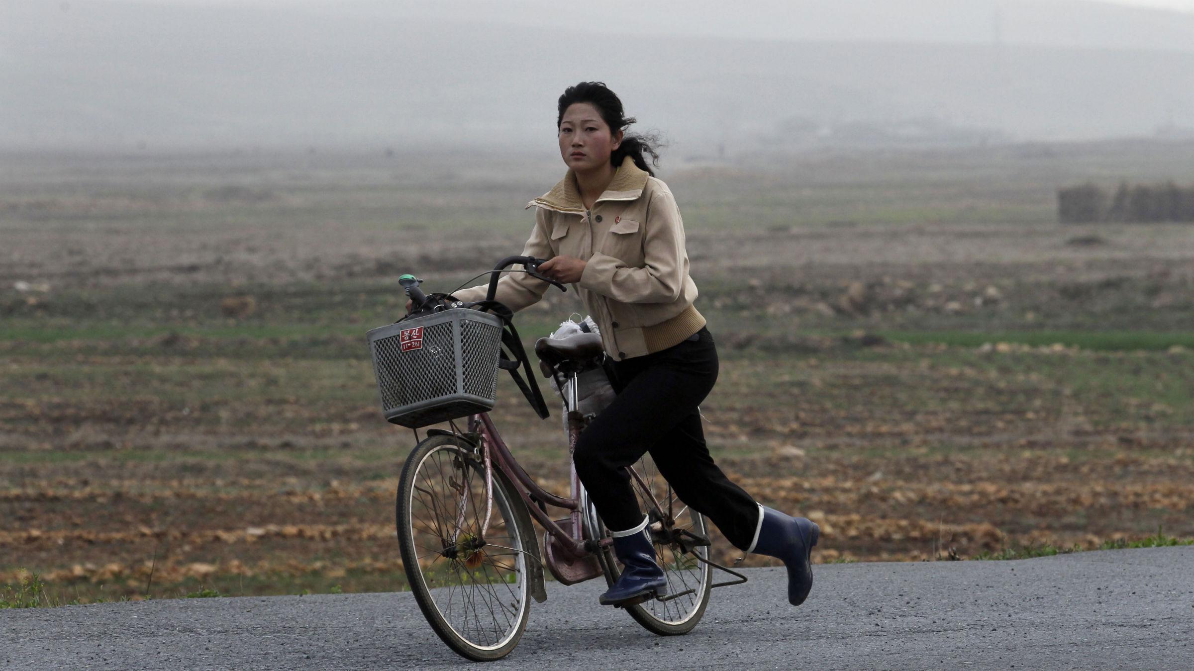 Woman on bike in North Korea