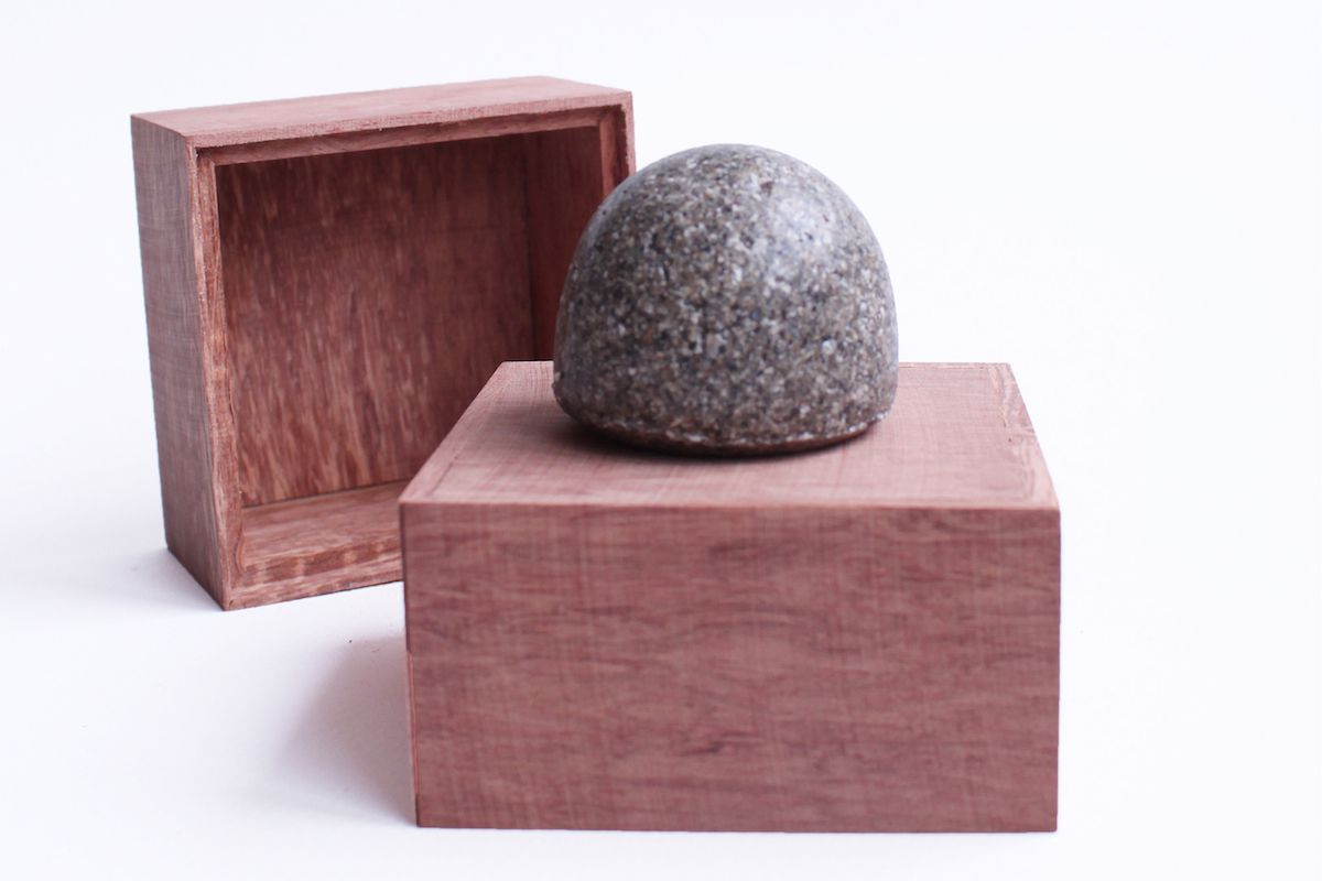 A memento made of animal ashes sits in a display box