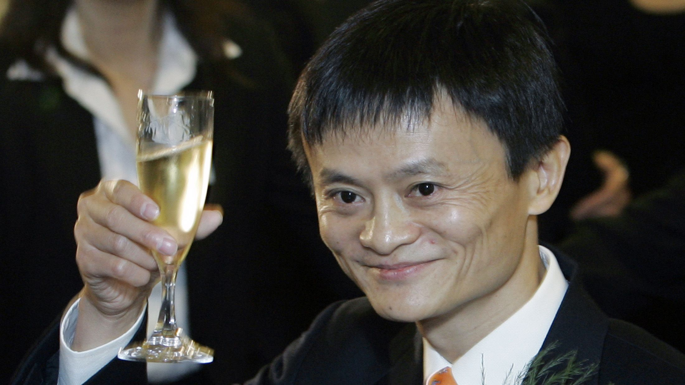 Ma Yun, founder and chief operating officer of China's Alibaba.com. toasts at the listing ceremony at the Hong Kong Stock Exchange, Tuesday, Nov. 6, 2007. Chinese e-commerce portal Alibaba.com made a strong debut on the Hong Kong stock market Tuesday, with its shares soaring 137 percent to 32 Hong Kong dollars (US$4.12; euro2.84) within minutes of its listing. (AP Photo/Kin Cheung yu'e bao alipay chinese banking shadow banking money market fund
