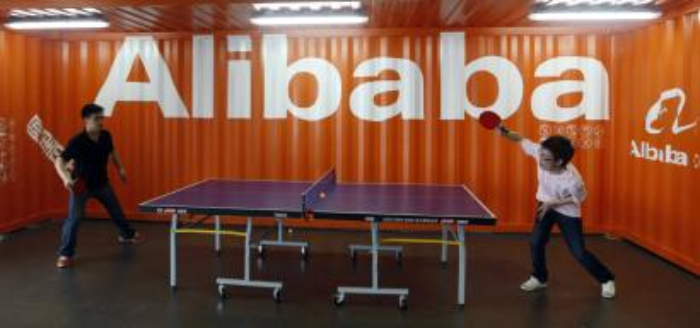 Alibaba employees play ping pong