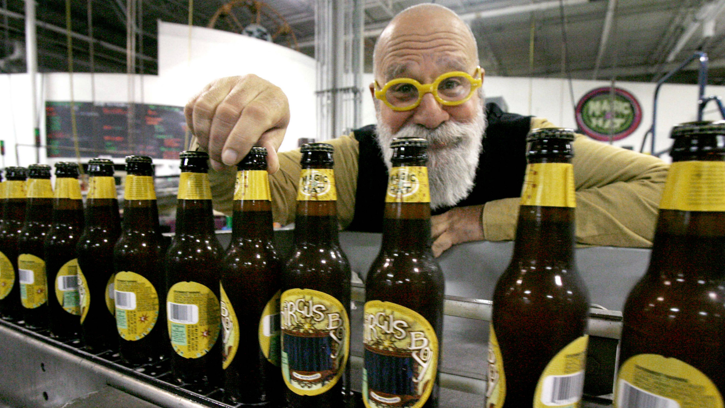 In this Dec. 6, 2007 file photo, CEO Alan Newman checks bottles on the production line at Magic Hat Brewery in South Burlington, Vt. Magic Hat Brewing Co., Vermont's largest craft brewery, has been sold to North American Breweries, Inc. of Rochester, N.Y.
