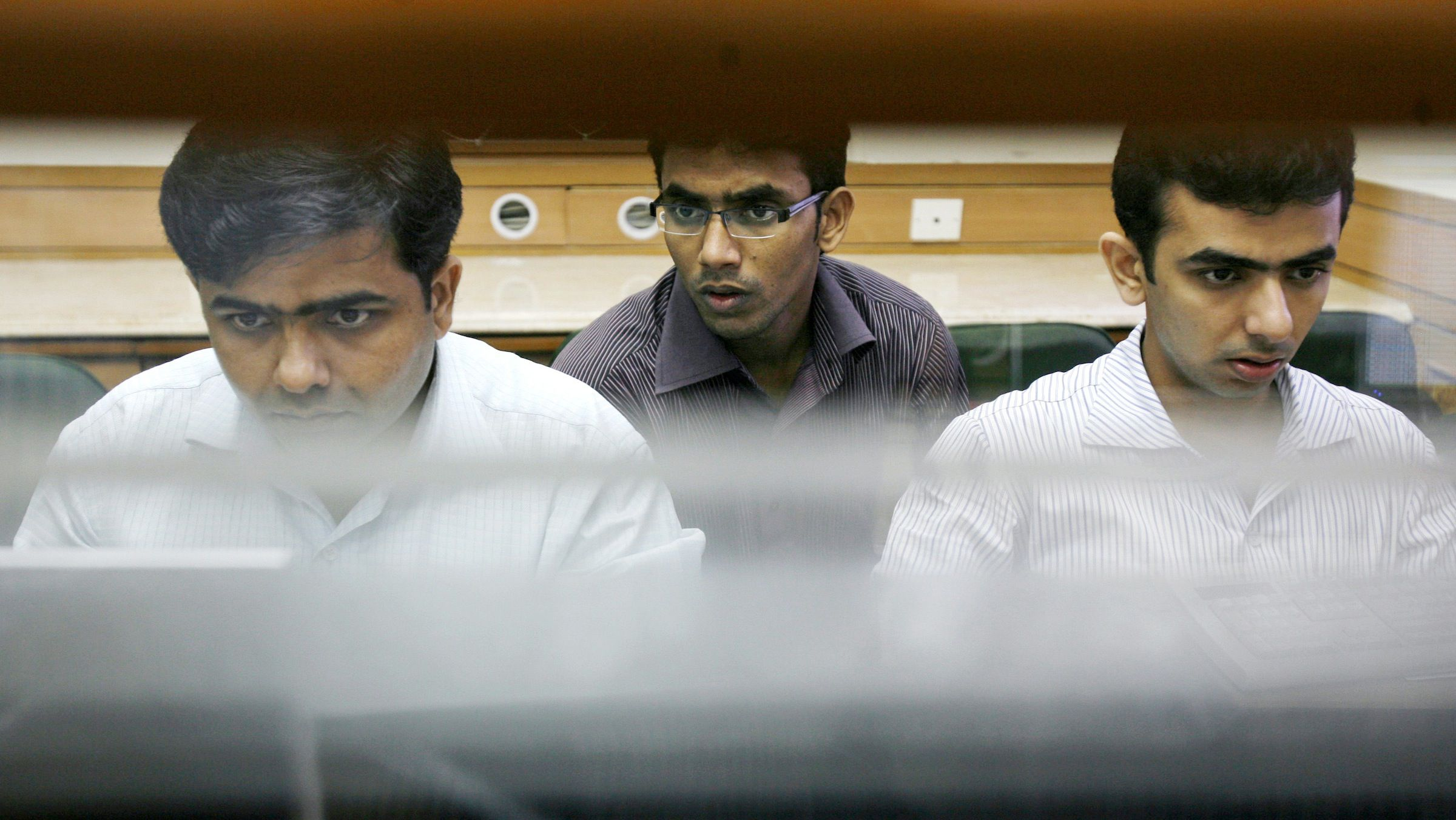 Brokers watch stock prices at a brokerage in Mumbai, India, Monday, Sept. 9, 2008. The Sensex jumped by 623 points Monday on heavy buying by foreign funds and retail investors after the Nuclear Suppliers Group gave a go-ahead for resumption of nuclear cooperation between India and US. (AP Photo/Gautam Singh)