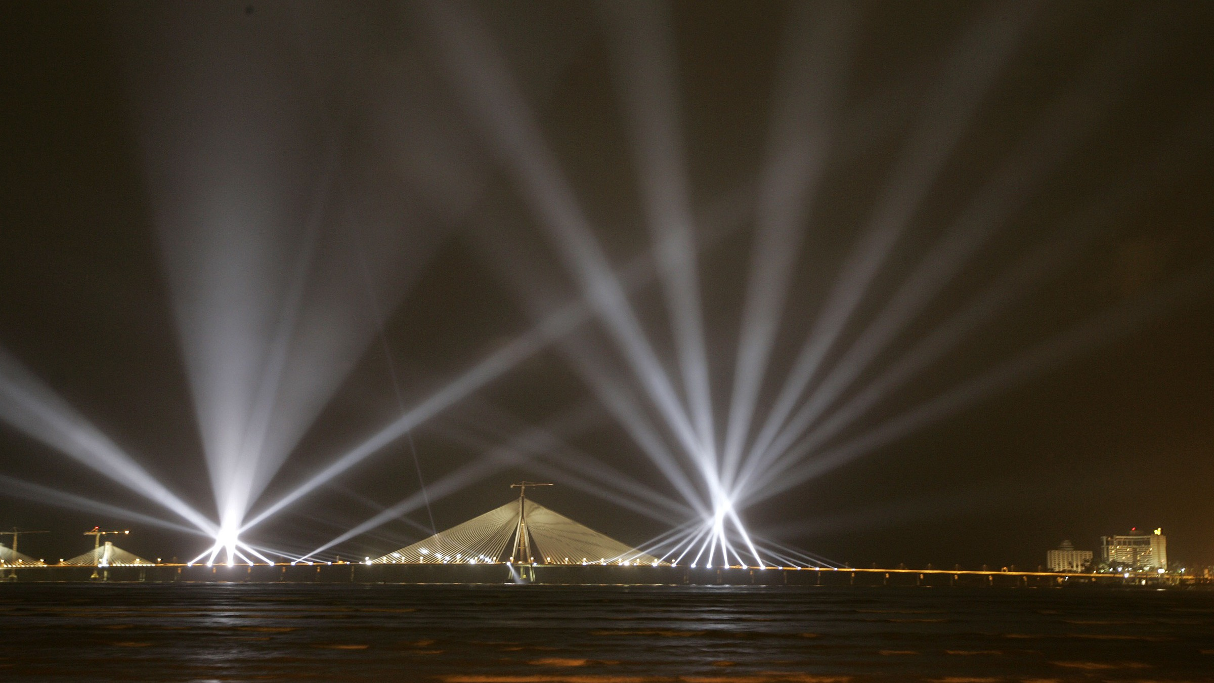 Rehearsal of laser show is seen at the 5.6 kilometers (3 miles) long Bandra-Worli Sea Link (BWSL) in Mumbai, India, Sunday, June 28, 2009. BWSL which will connect the suburban Bandra with Worli in south Mumbai will be inaugurated on June 30. (AP Photo/Rajanish Kakade)