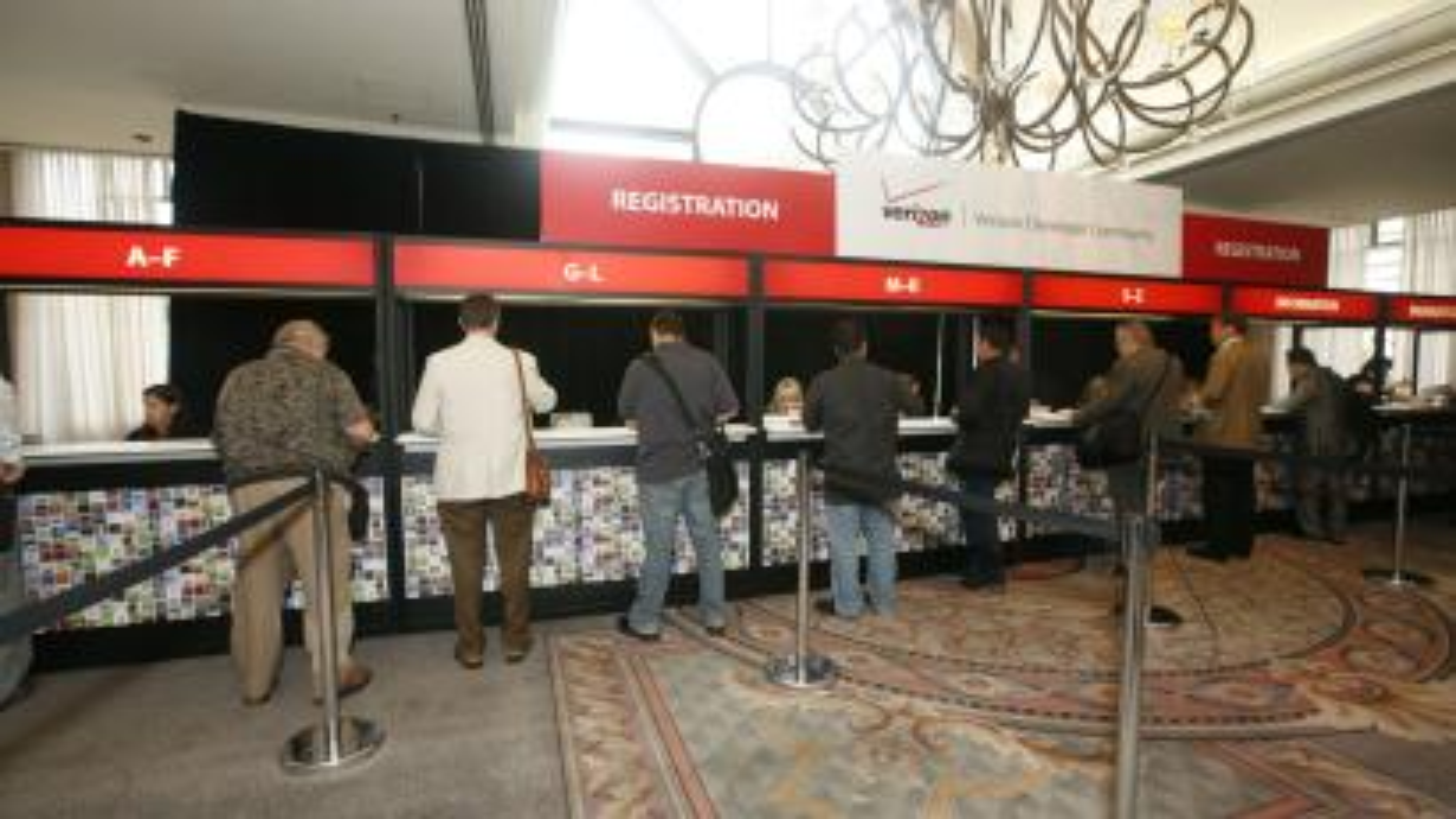 Men register for a conference