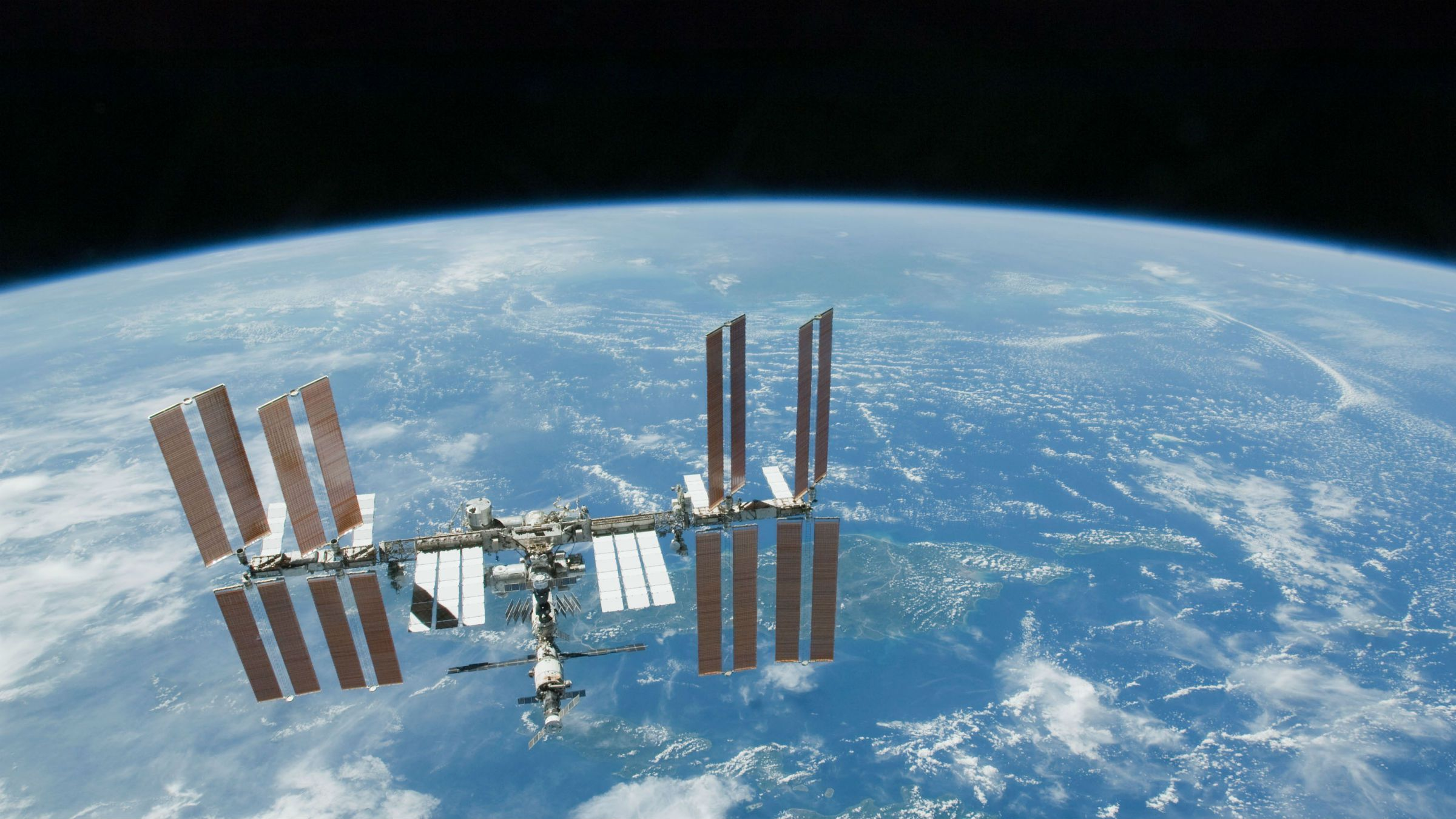 This Feb. 19. 2010 file photo provided by NASA shows the International Space Station with Earth's horizon as a backdrop. Several power systems have been shut down aboard the International Space Station after a cooling system malfunctioned. NASA says in a posting on its website that one of two cooling loops aboard the space station was shut down Saturday, July 31, 2010. A module that pumps ammonia coolant to prevent equipment from overheating was still shut down early Sunday, Aug. 1. (AP Photo/NASA, File