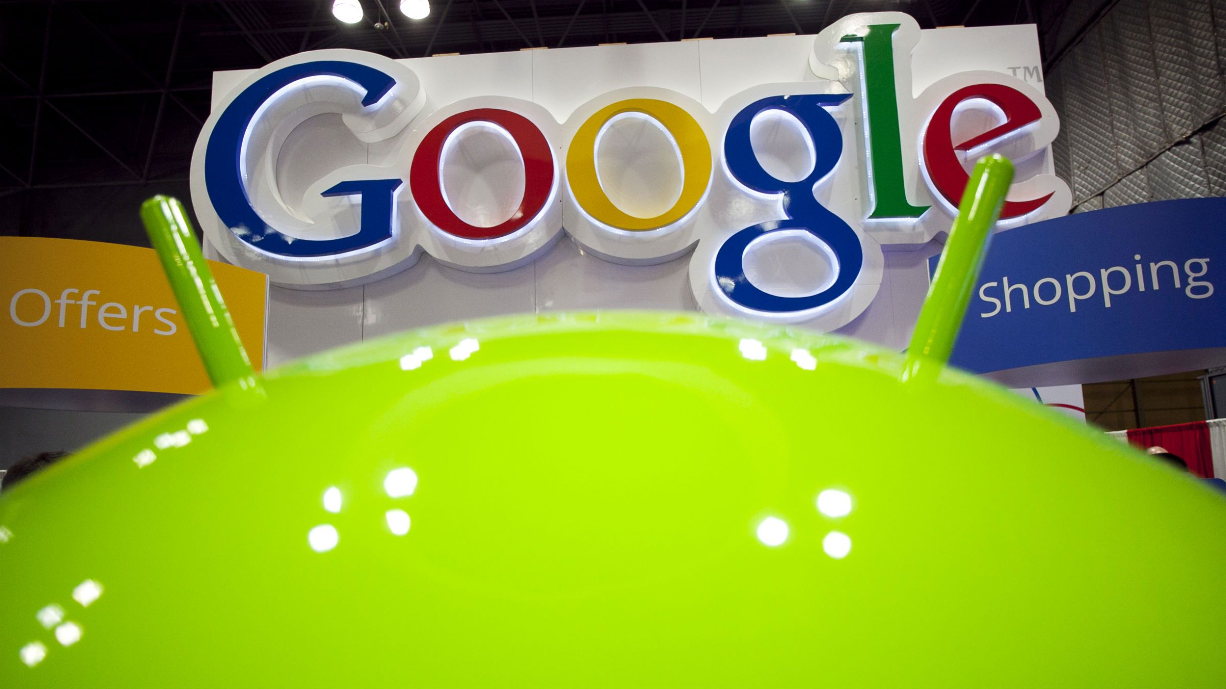 In this Jan. 17, 2012 photo, a sign for Google is displayed behind the Google android robot, at the National Retail Federation, in New York. Google Inc., releases quarterly financial results Thursday, Jan. 19, 2012, after the market close. (AP Photo/Mark Lennihan)