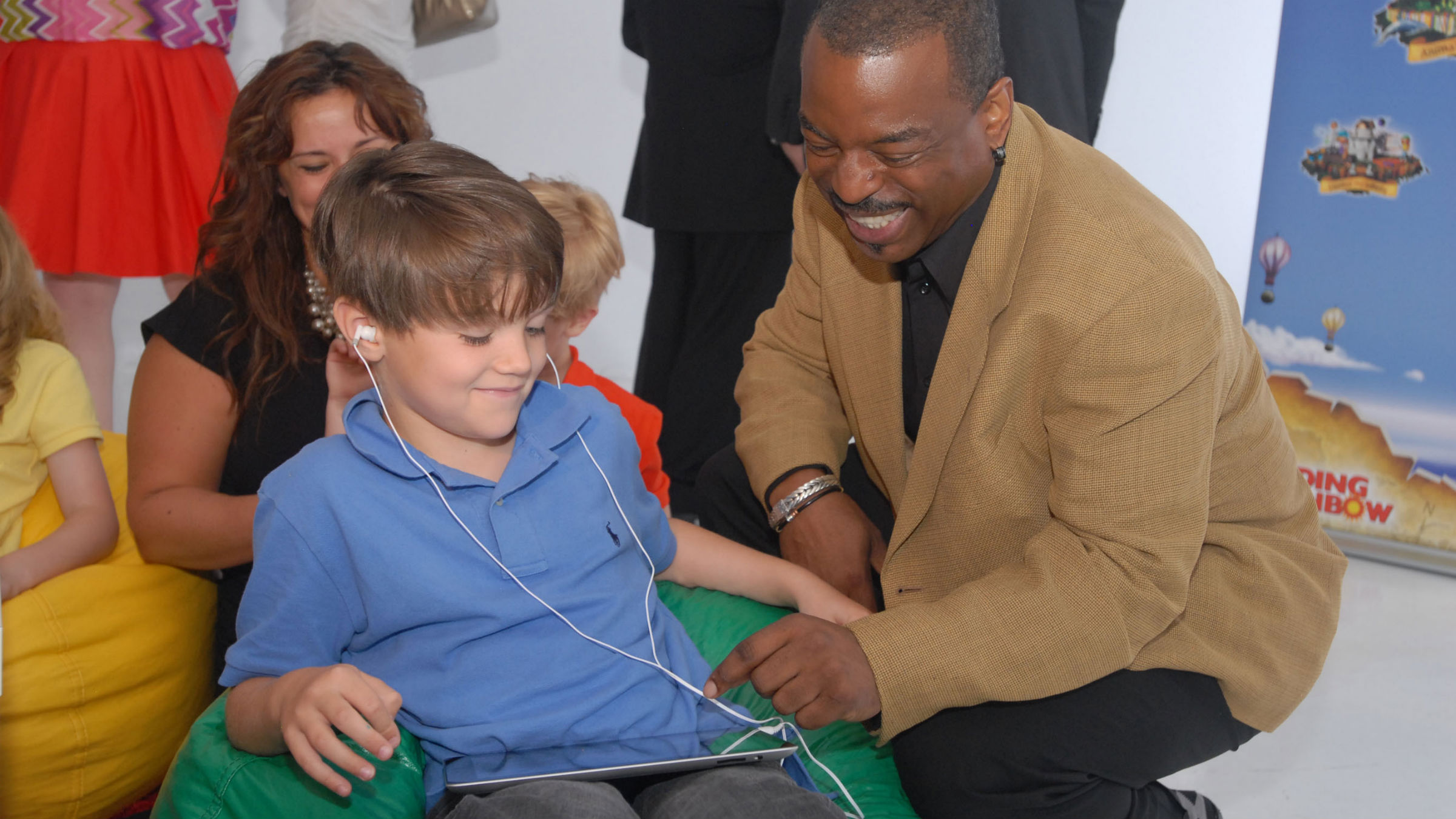 "LeVar Burton and 7 year old Shane Ammon exploring the all Reading Rainbow adventure app at the ""Reading Rainbow Relaunch"" event, June 19, 2012 New York."