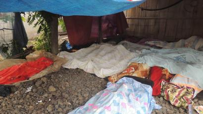 Bodies of victims in the brazen attack by about 40 to 50 Abu Sayyaf militants are covered in blankets at a makeshift morgue in Talipao township in Jolo in southern Philippines